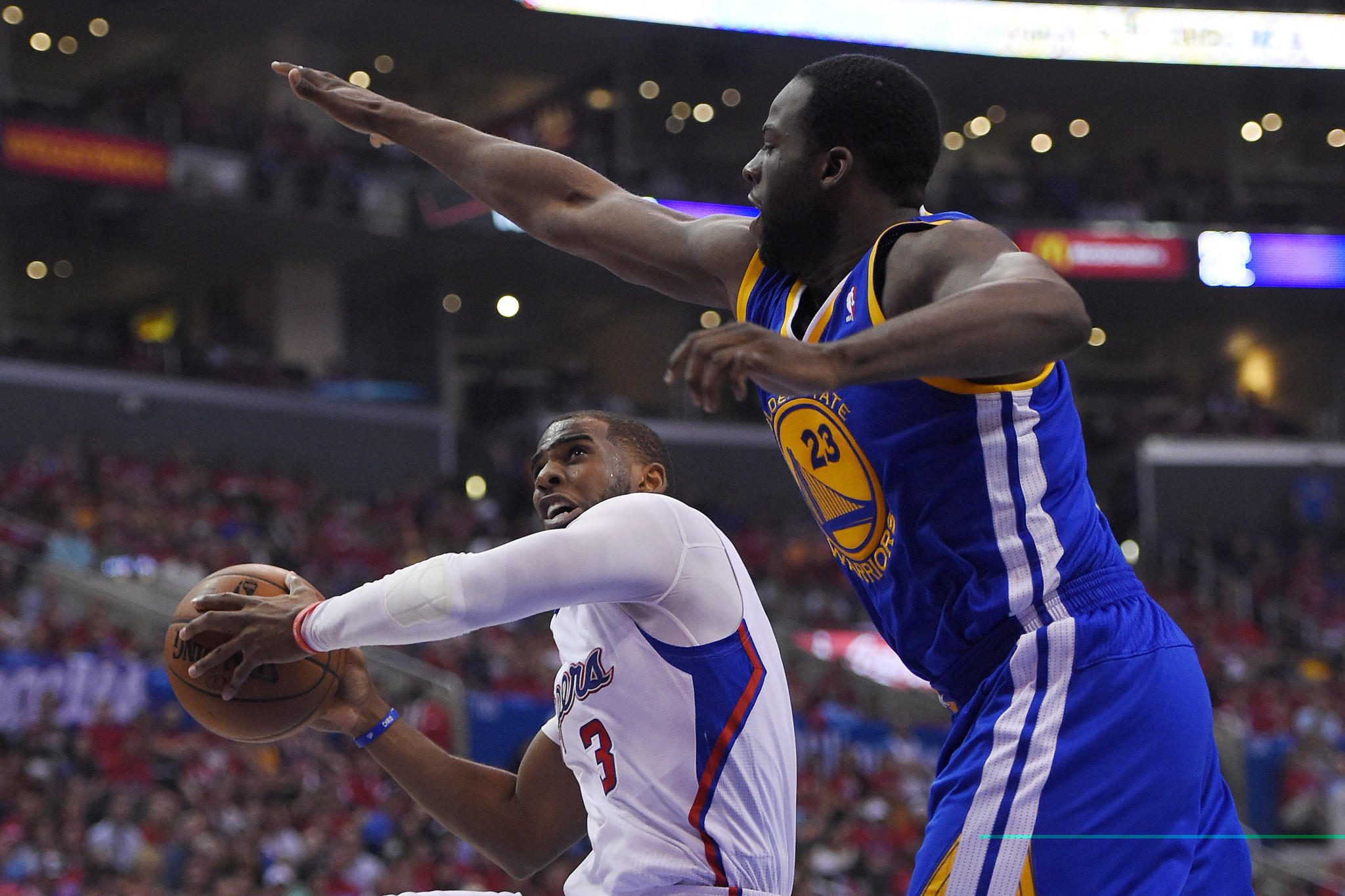 The Clippers' Chris Paul goes up for a shot Saturday against Golden State's Draymond Green.