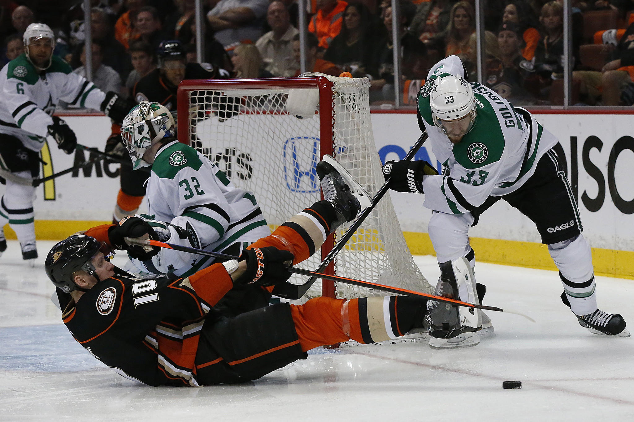 Ducks winger Corey Perry (10) is knocked to the ice by Dallas defenseman Alex Goligoski in Game 2 of a Stanley Cup playoff series at the Honda Center.