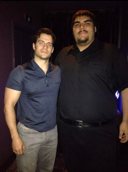 Actor Henry Cavill (left) poses for a photo at Vertigo Sky Lounge in the Dana Hotel & Spa with bouncer Alex Quintero (right) April 20, 2014.