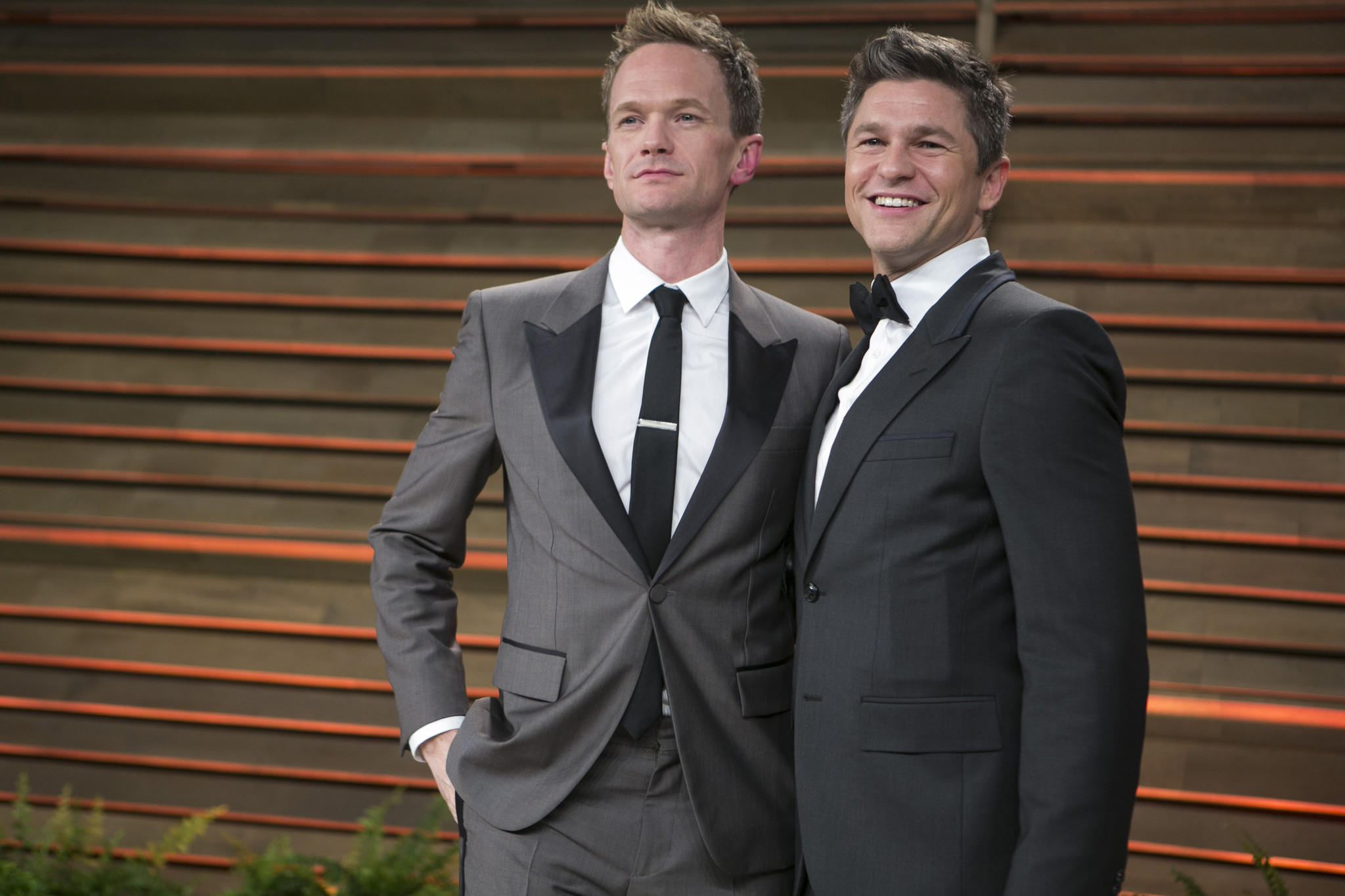 "Neil Patrick Harris says it was his character, not the actor himself, who cursed at an audience member during a performance of ""Hedwig and the Angry Inch."" Above, Harris and his husband, David Burtka, arriving at the Vanity Fair Oscar party last month."