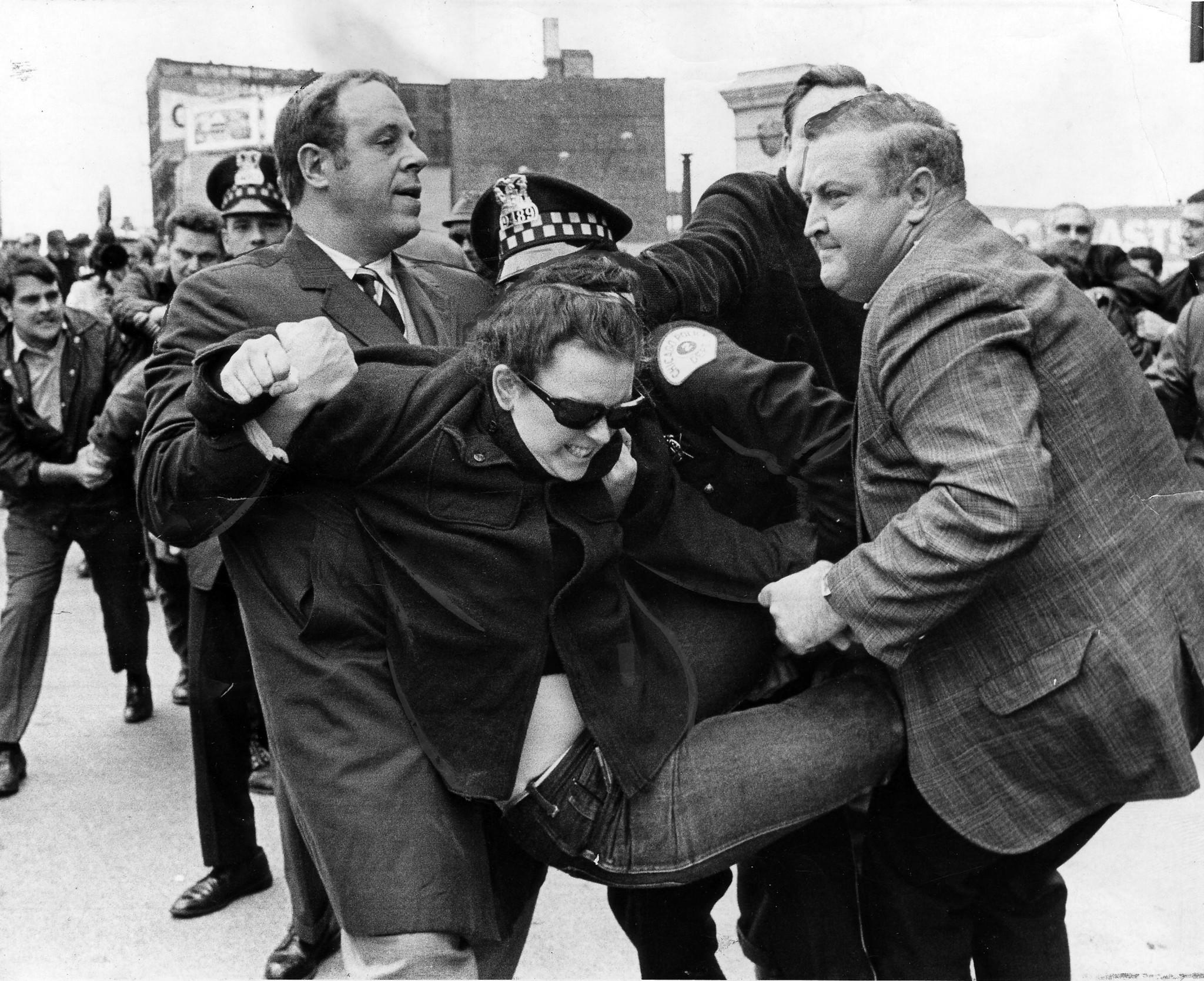 Richard Elrod, left, an assistant city corporation counsel, tries to subdue a rioter during the Days of Rage riots. Elrod was partially paralyzed during a scuffle later in the day.