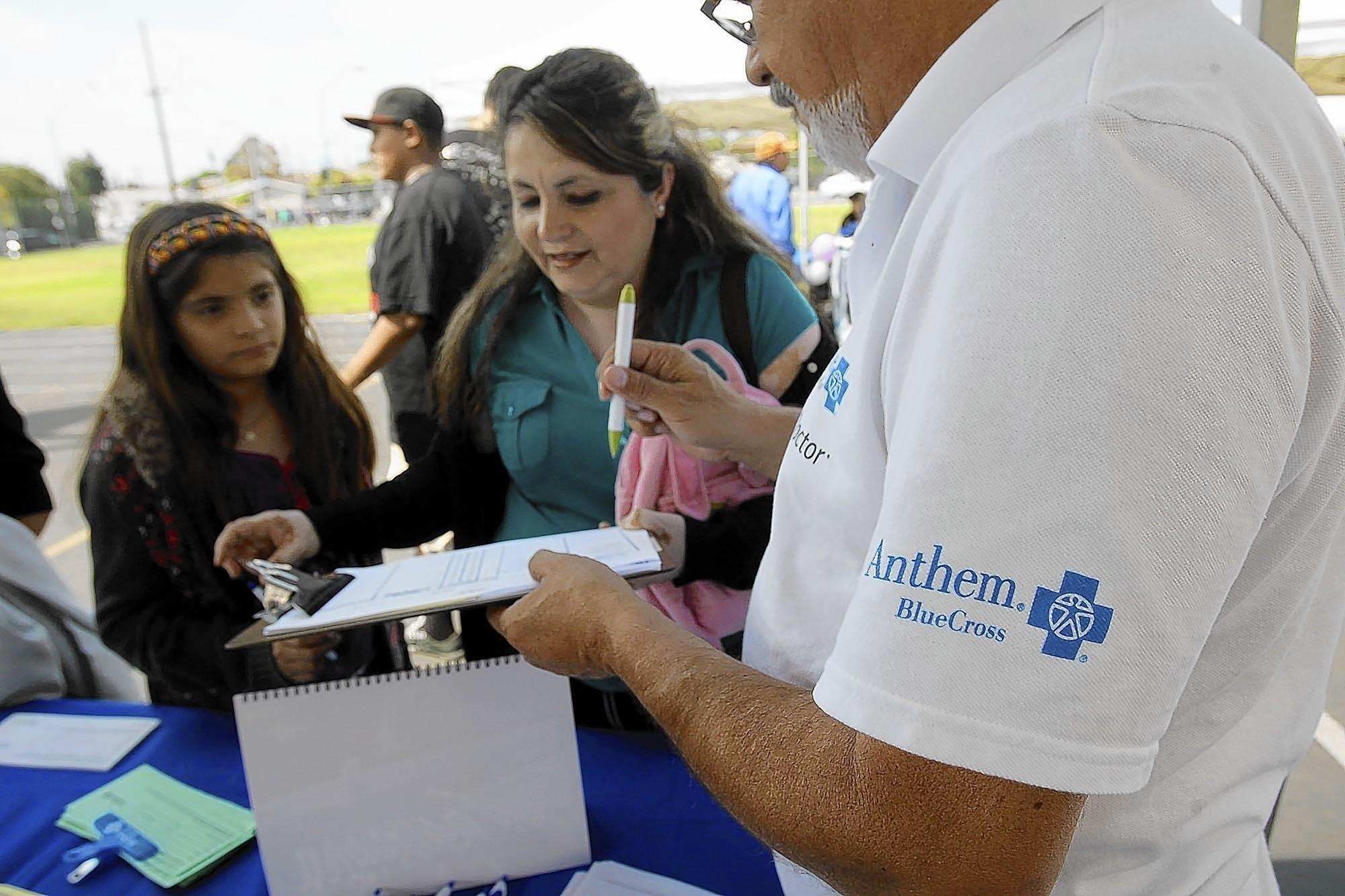 Insurance giant Anthem Blue Cross signed up 425,058 people through April 15, or 30.5% of Covered California's exchange market under the Affordable Care Act, new data show. Above, an Anthem booth at an East Los Angeles health fair last year.