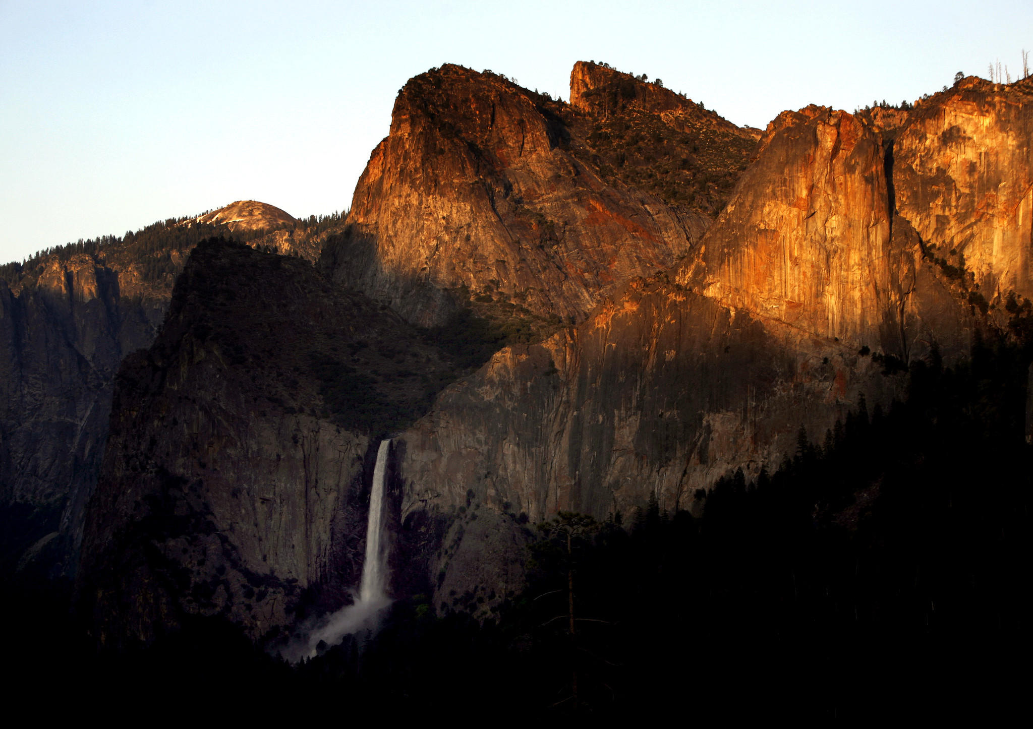 Bridalveil Fall and Cathedral Rocks in Yosemite National Park. A mountain climber was rescued Sunday, after he fell 30 feet while climbing nearby Higher Cathedral Spire.