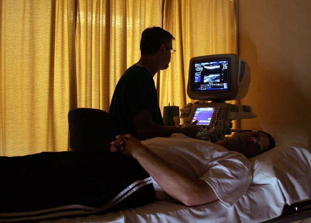 A patient receives an ultrasound of the carotid artery. Carotid artery stenosis can cause strokes, but a new study says it may also slow down mental processing even in the absence of a stroke.
