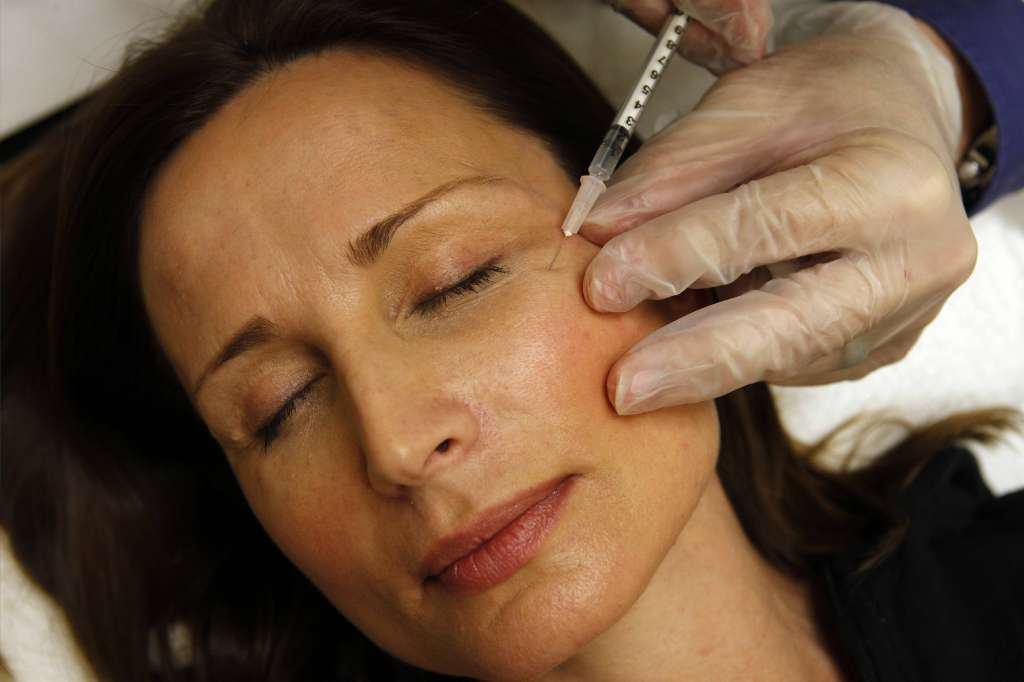 Colleen Delsack of Virginia receives a Botox injection. Valeant Pharmaceuticals International Inc. said it hopes to acquire Botox maker Allergan Inc., which is based in Irvine.