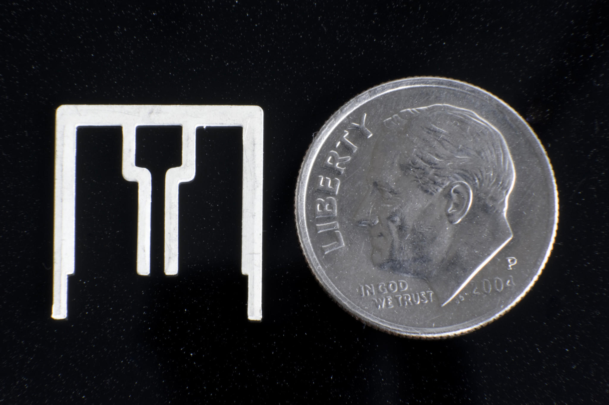 An Aereo TV antenna, next to a dime to show its size. The company's use of these devices lies at the heart of a dispute with broadcasters that the Supreme Court is hearing Tuesday.