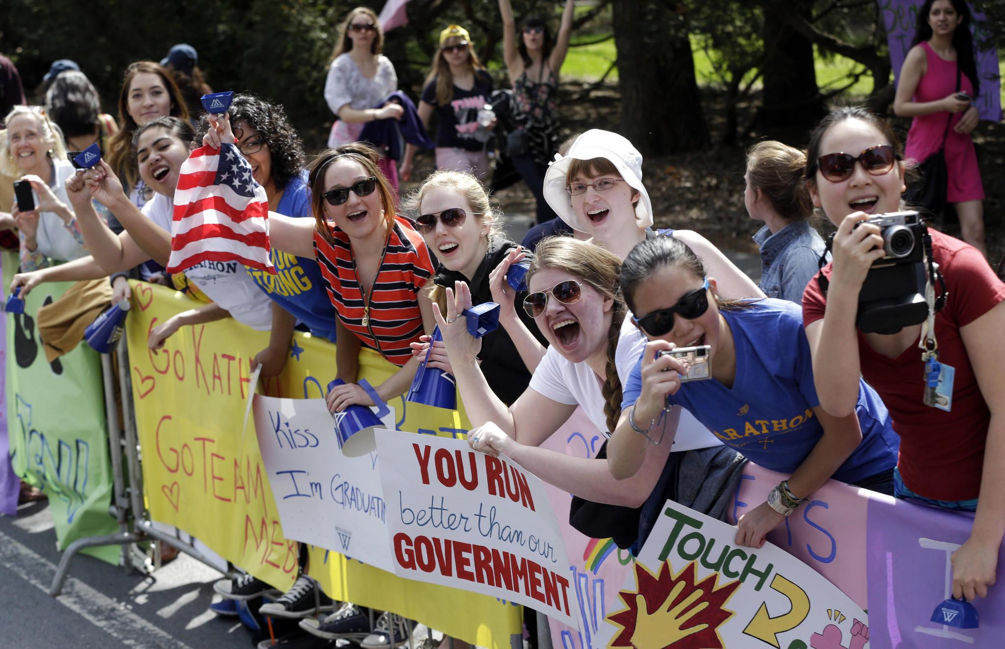 Spectators cheer near Wellesley College along the route of the 118th Boston Marathon.