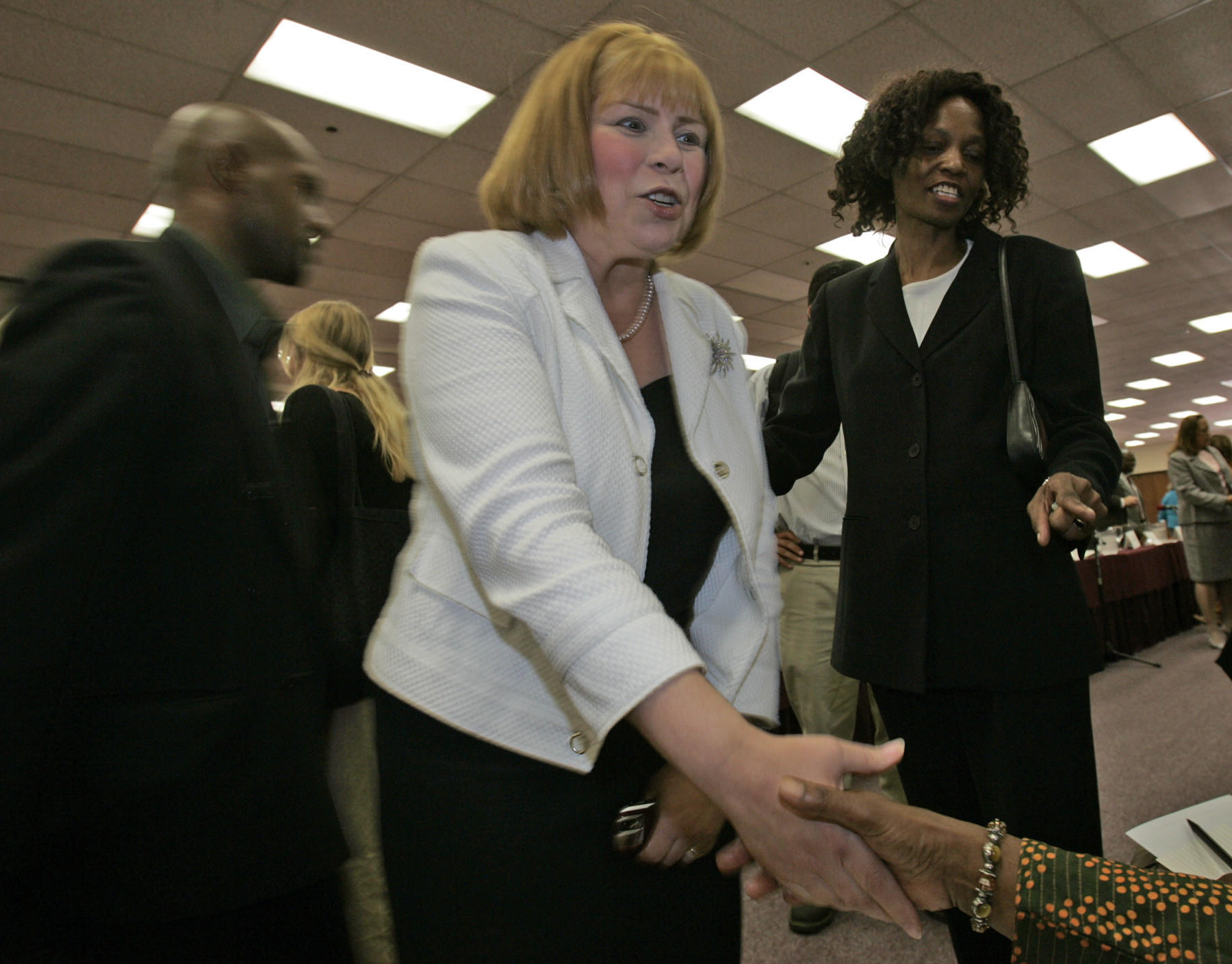 State Sen. Jenny Oropeza, center, greets audience members at a candidates forum in 2007.