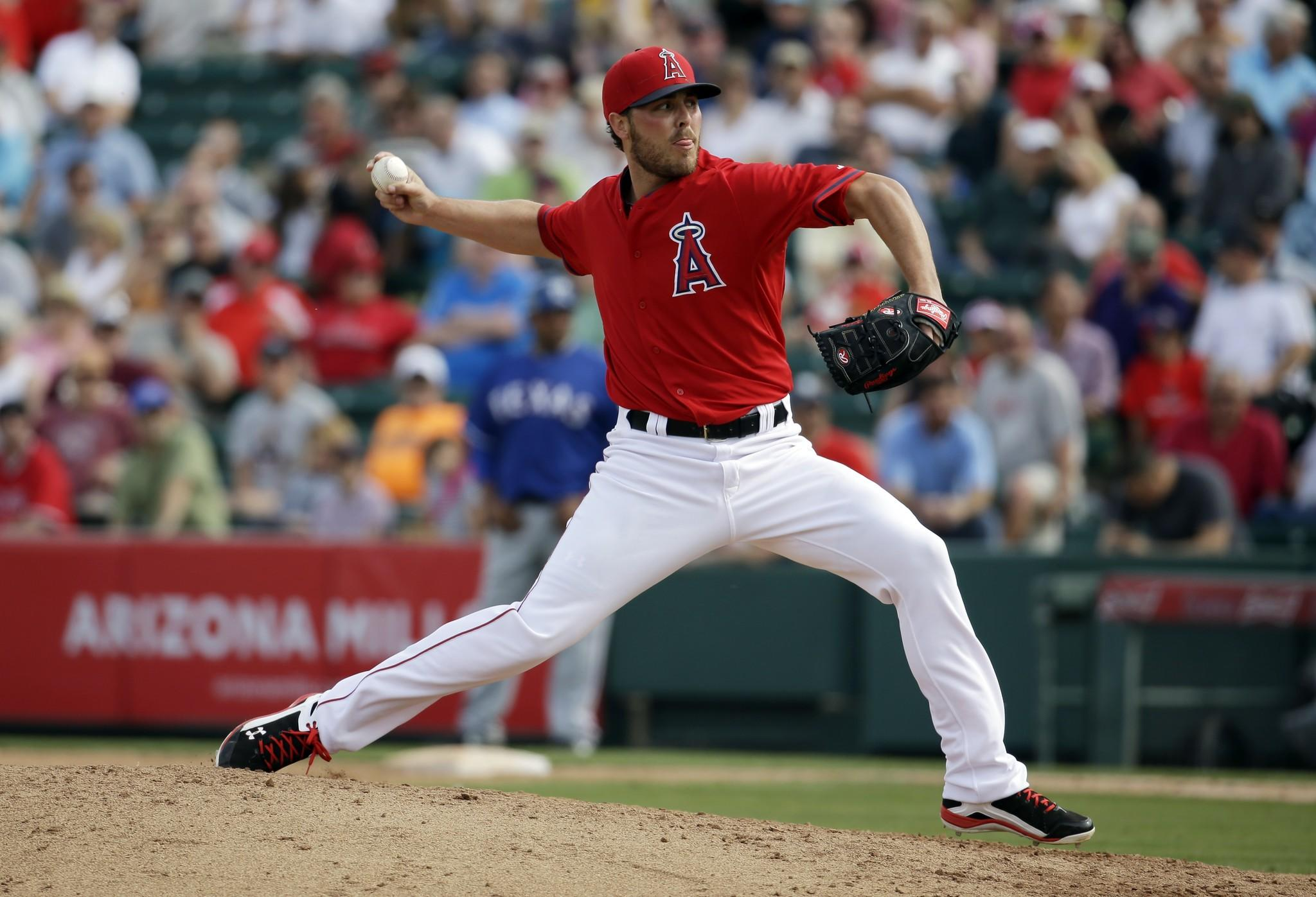 Angels reliever Michael Kohn delivers a pitch during an exhibition game against the Texas Rangers in March.