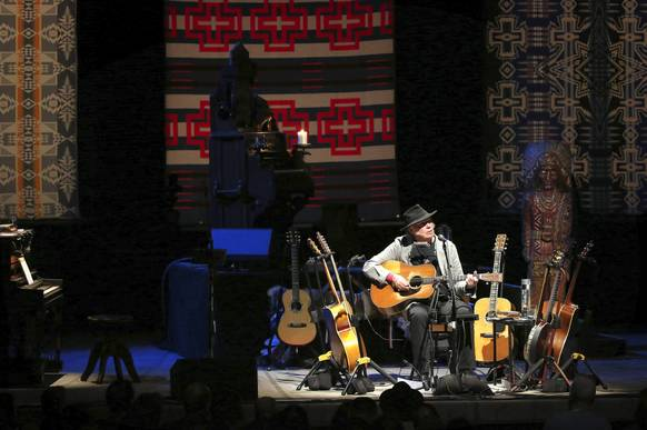 Neil Young performs at the Chicago Theatre.