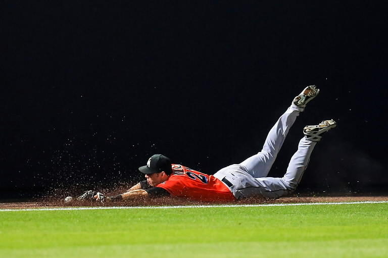 Miami Marlins left fielder Christian Yelich (21) makes a diving attempt on a Atlanta Braves center fielder Jordan Schafer (17) double in the ninth inning at Turner Field.
