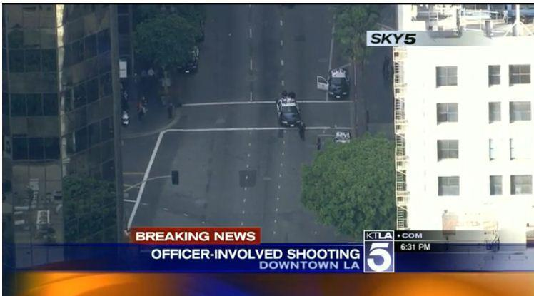 Officers near the scene where a man was shot in a confrontation with LAPD officers in downtown L.A.