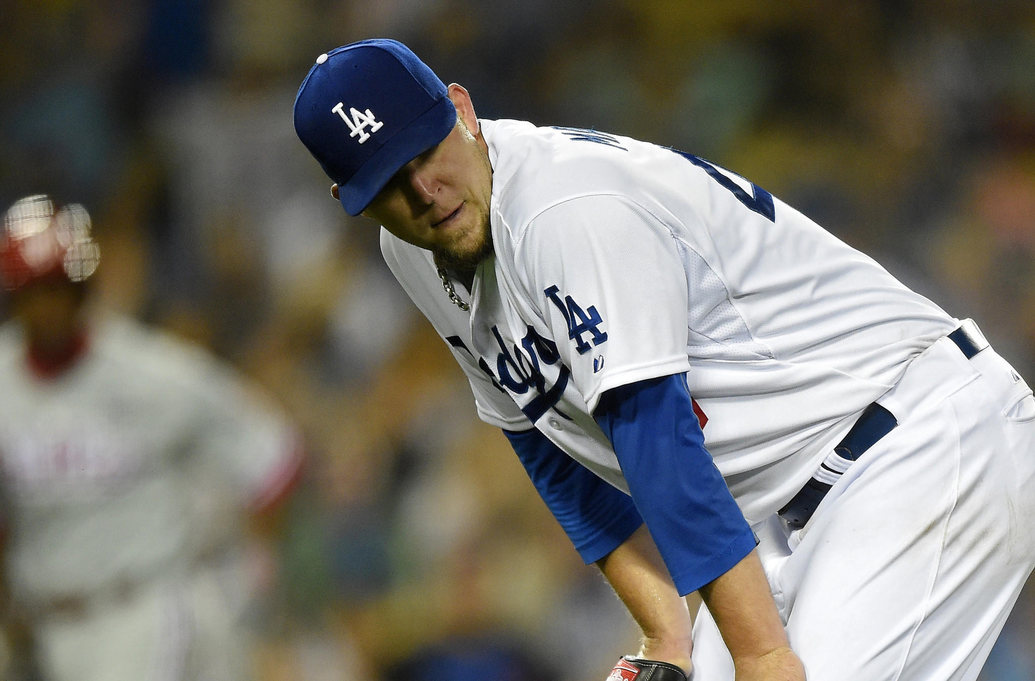 Dodgers starter Paul Maholm looks on after giving up a run on his throwing error to first base during the fifth inning of the Dodgers' 7-0 loss Monday at Dodger Stadium.