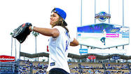 Photo Gallery: Olympian Kate Hansen throws out first pitch of Dodger game