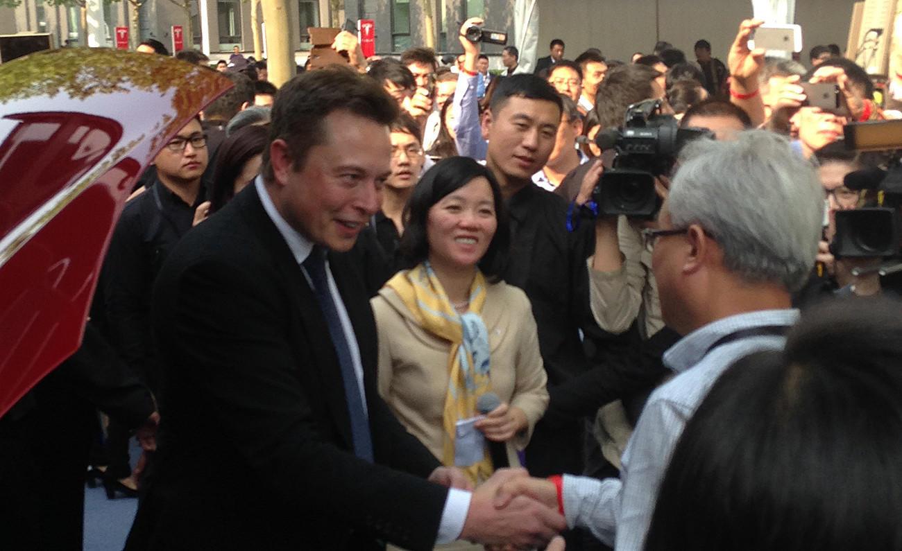 Tesla Chief Executive Elon Musk greets customers in Beijing.
