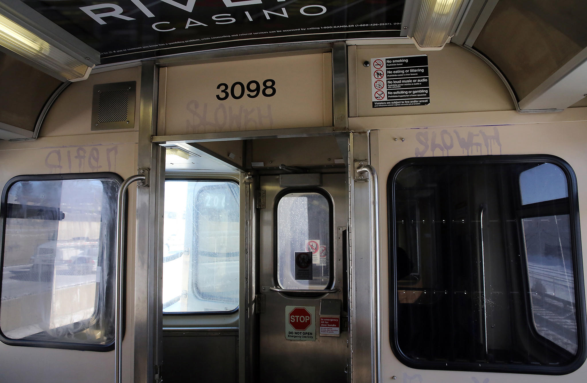 Blue line CTA rail car with graffiti.