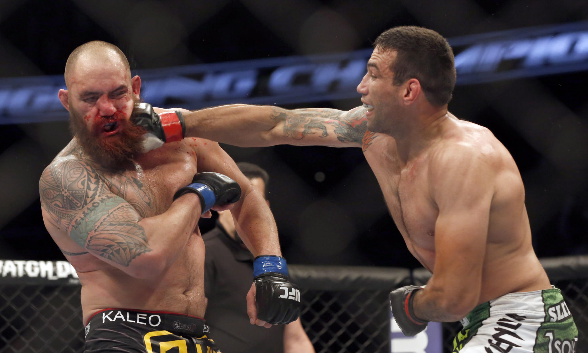 Fabricio Werdum, right, hits Travis Browne during their UFC bout on Saturday.