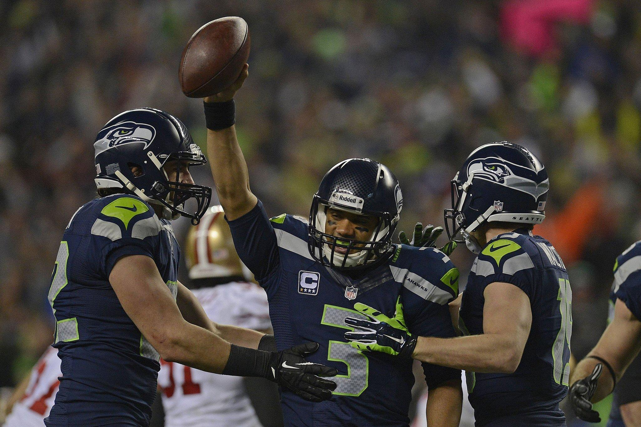 Seattle quarterback Russell Wilson raises his arm in celebration after the Seahawks defeated the San Francisco 49ers in the NFC championship game Jan. 19.