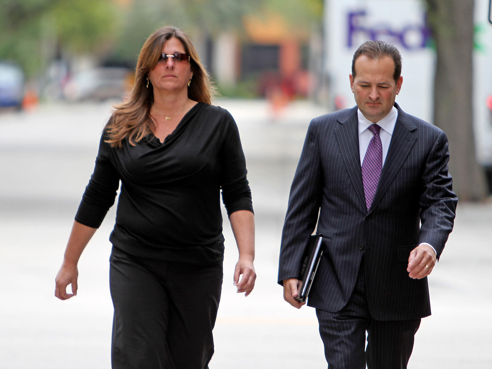 Scott Rothstein's former CFO Irene Stay Shannon pleaded guilty to conspiracy to commit money laundering and bank fraud. This file photo shows her leaving federal court in Fort Lauderdale last month, with her attorney Brian Tannebaum. Susan Stocker, Sun Sentinel