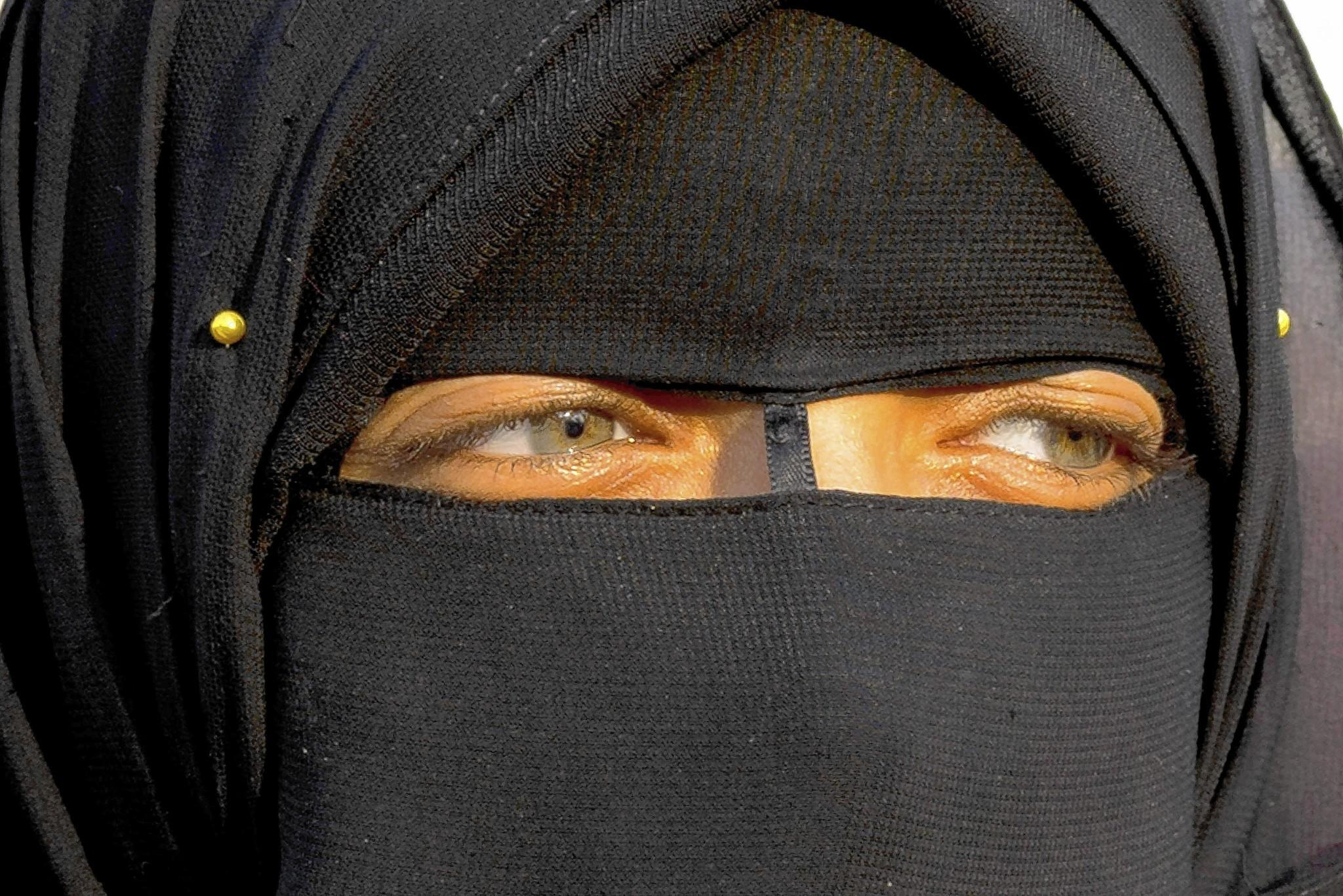 A woman attends a political rally in Cairo last year. Female genital excision has been banned in Egypt since 2008, but the procedure is common, especially away from urban areas.