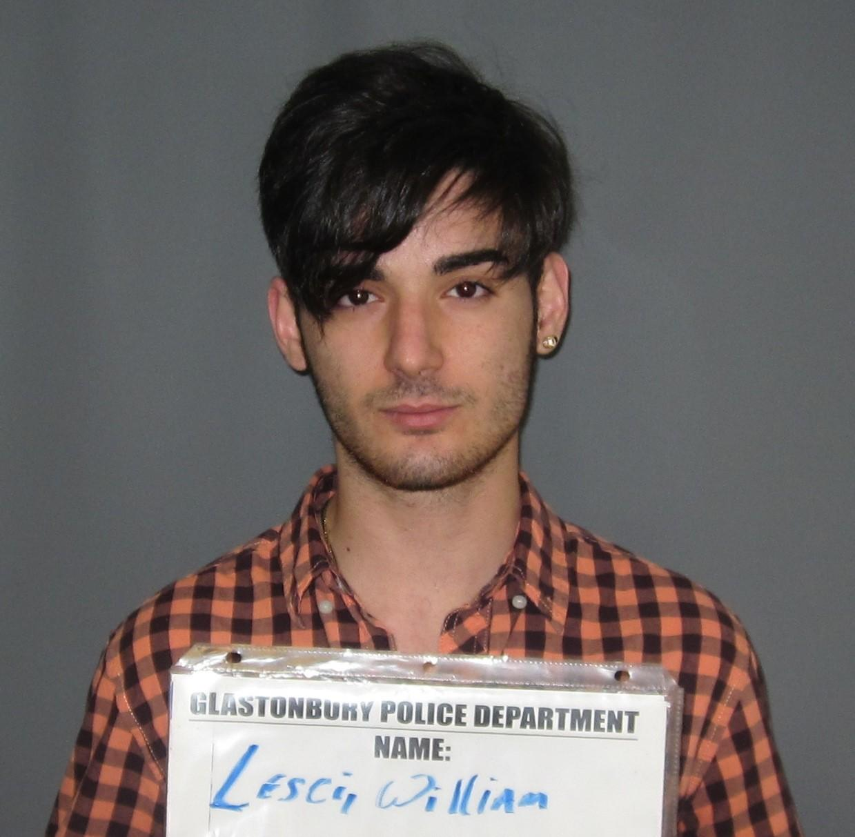 William Lesci was charged with second-degree breach of peace, carrying a weapon on school grounds and carrying a weapon.
