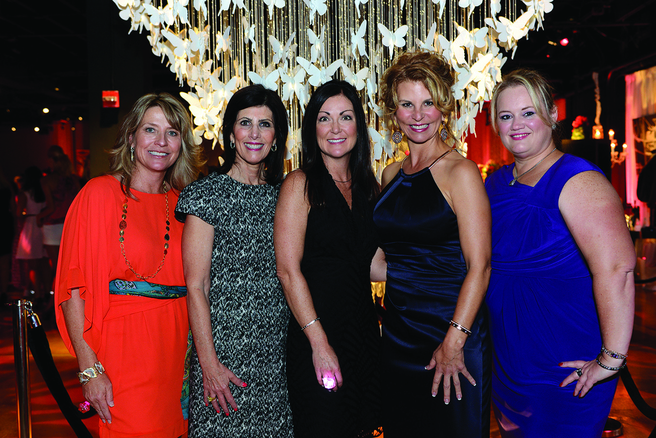 Society Scene photos - Julie Southern, left, Ronda Finkelstein, Elizabeth Cambareri, Kathleen Cannon and Tanya Bower wore fun and colorful dresses for the United Way of Broward County