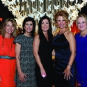 "Julie Southern, left, Ronda Finkelstein, Elizabeth Cambareri, Kathleen Cannon and Tanya Bower wore fun and colorful dresses for the United Way of Broward County's inaugural ""Wine, Women & Shoes"" event at the Gallery of Amazing Things in Dania Beach."