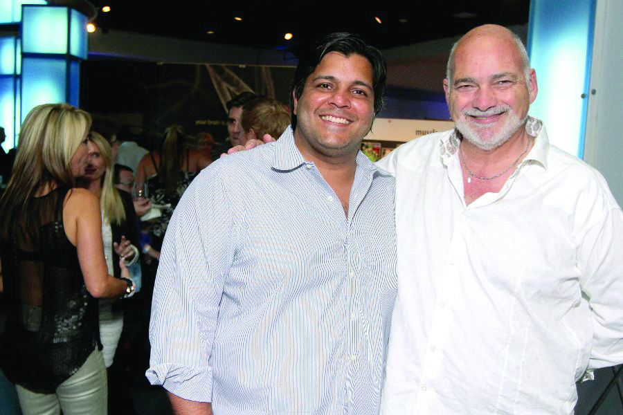 "Society Scene photos - Dev Motwani, left, and Albert Miniaci partook in the array of wine samples at the 19th annual ""Bank of America Wine, Spirits and Culinary Celebration,"" which took place at the Museum of Discovery and Science. The event raised more than $175,000 with proceeds benefiting the museum."