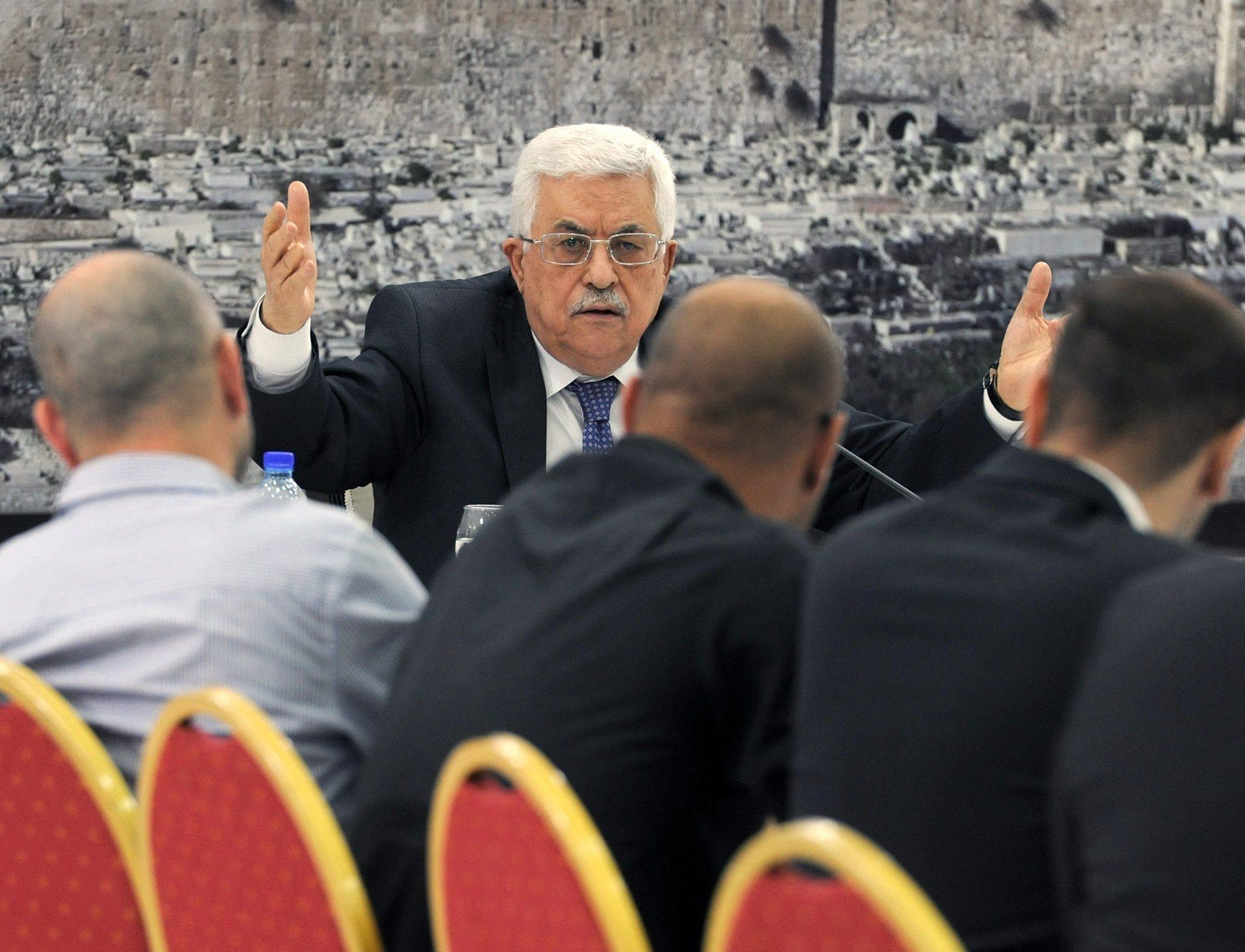 Palestinian Authority President Mahmoud Abbas, center, meets with members of the Palestinian leadership in Ramallah, West Bank.
