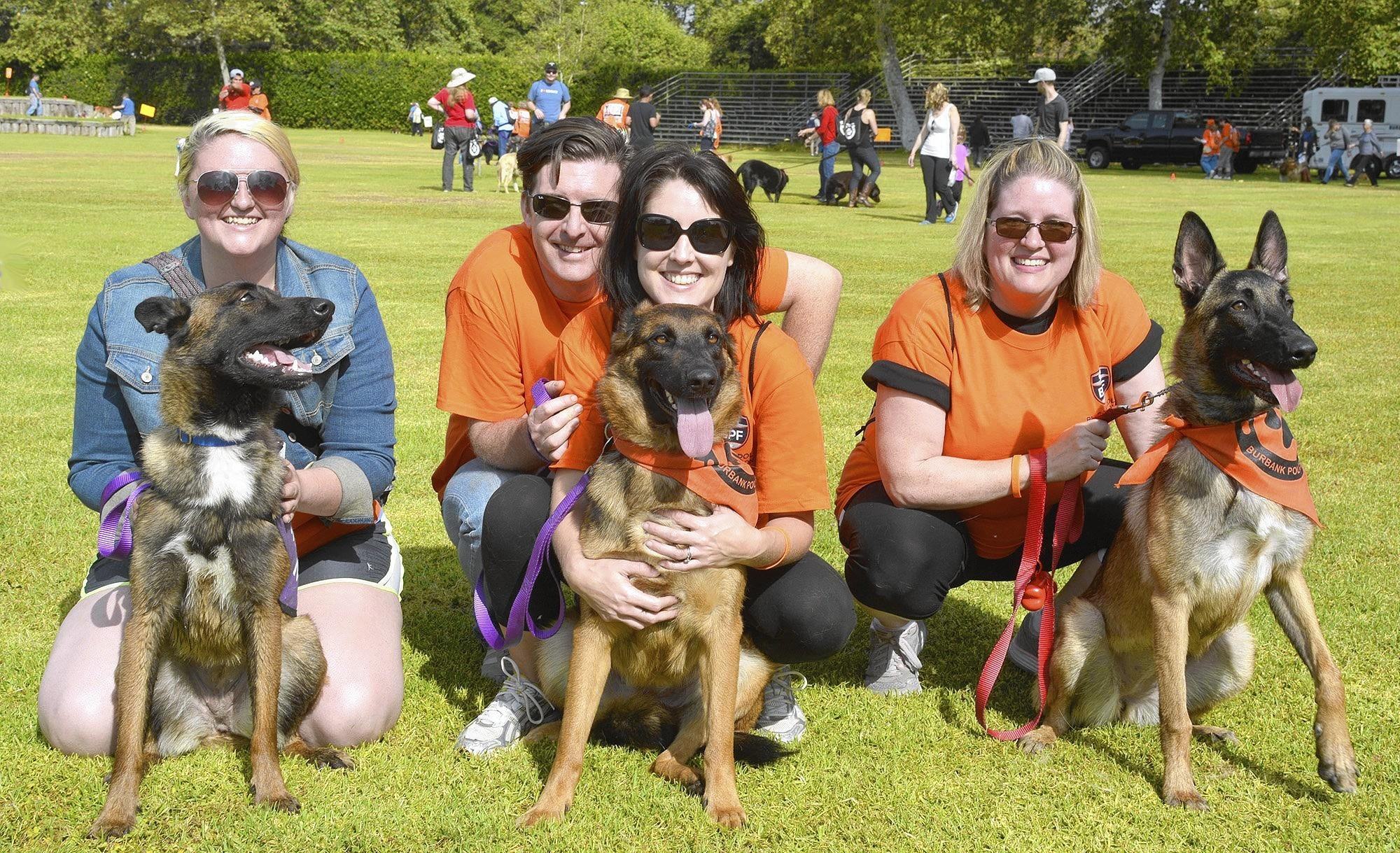 Among those who participated in Saturday's Hoof and Walk were, from left, Tyrannie Whetstone and Gretchen, Gregory and Christine VanGrunsven and Sara, and Sheira Whetstone and Elphie of The Animal Protectorates.