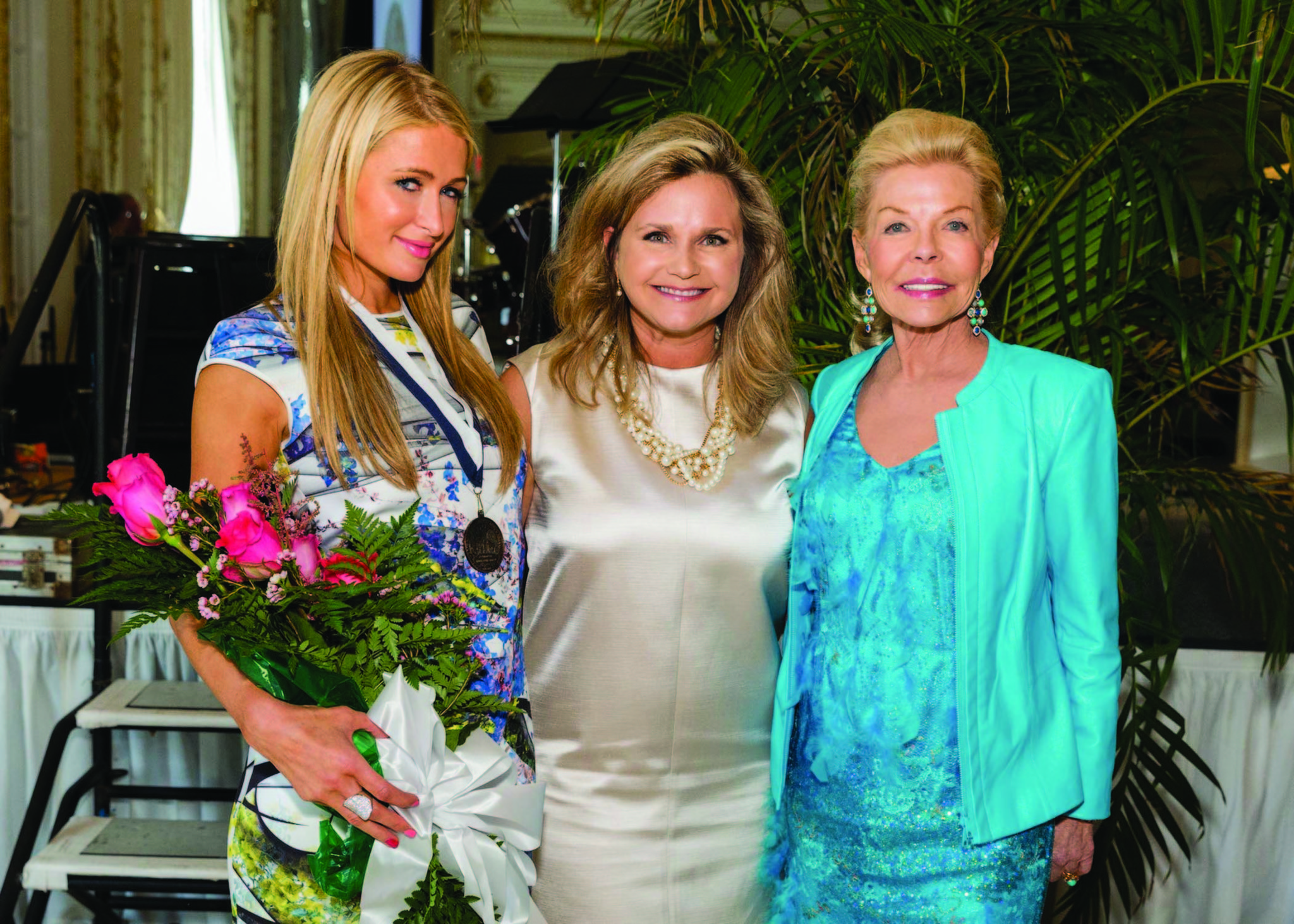 Celeb-spotting around South Florida - Paris Hilton, left, Dr. Robin Ganzert and Lois Pope looked classic in spring colors for the American Humane Association