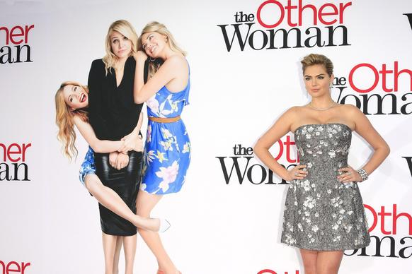 "Kate Upton wears a Dolce & Gabbana dress to the Los Angeles premiere of ""The Other Woman""  at the Regency Village Theater in Westwood."