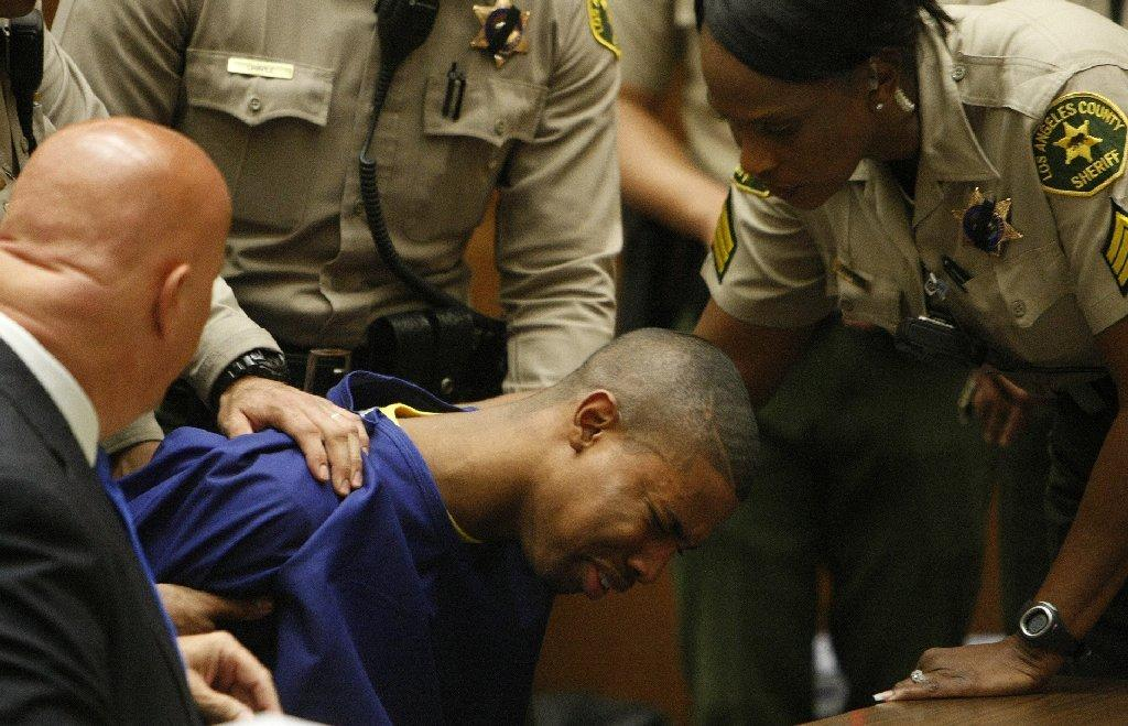 Brandon Spencer, being consoled by his attorney and surrounded by L.A. County Sheriff's deputies, is seen last week breaking down in a Los Angeles County Superior courtroom after being sentenced to 40 years to life in prison for a shooting that wounded four people outside a Halloween party at USC in 2012.