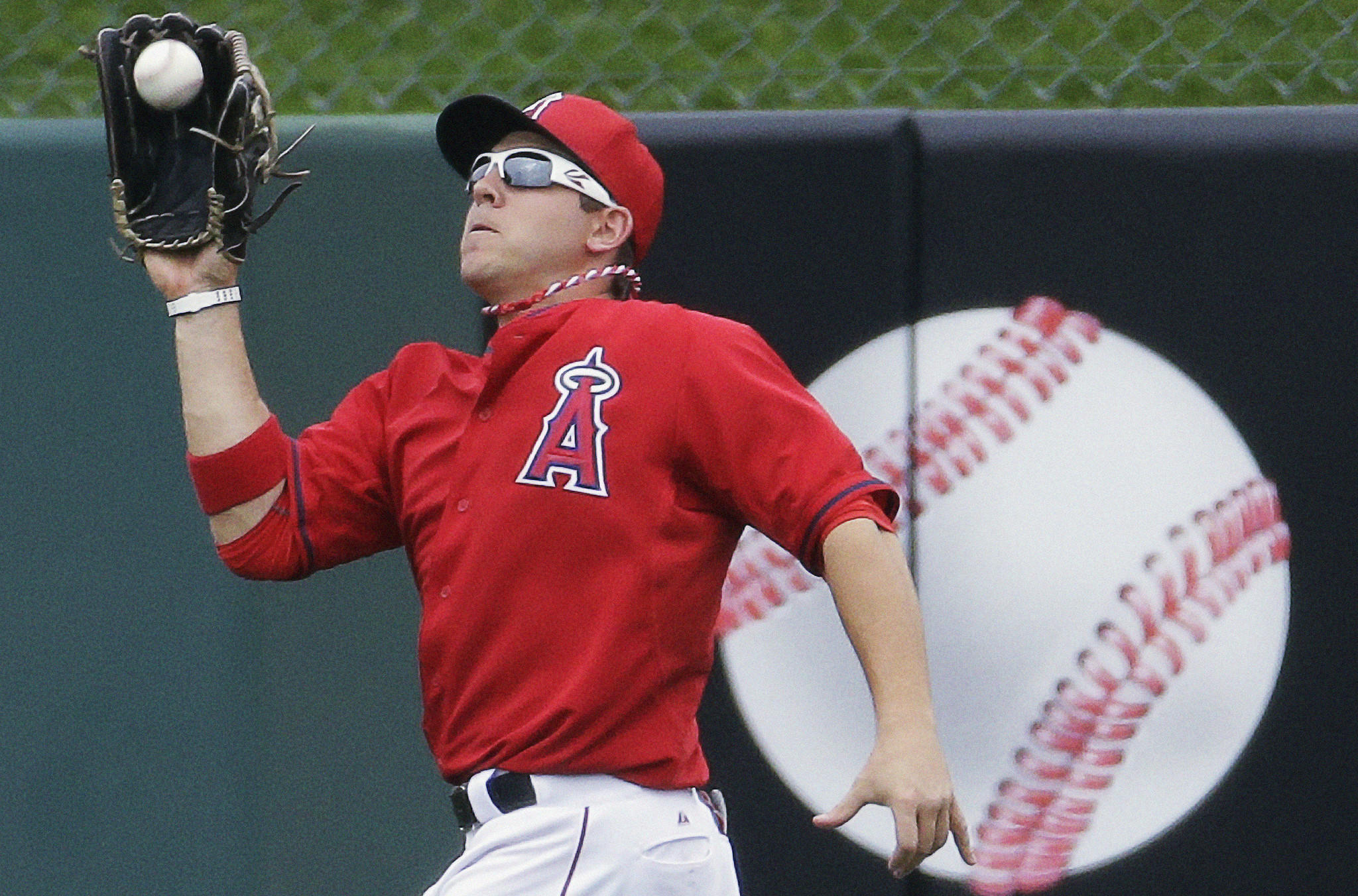 Angels outfielder J.B. Shuck catches a fly ball during an exhibition game against the Dodgers in March. Shuck's throwing accuracy and quick release makes him a threat to baserunners.