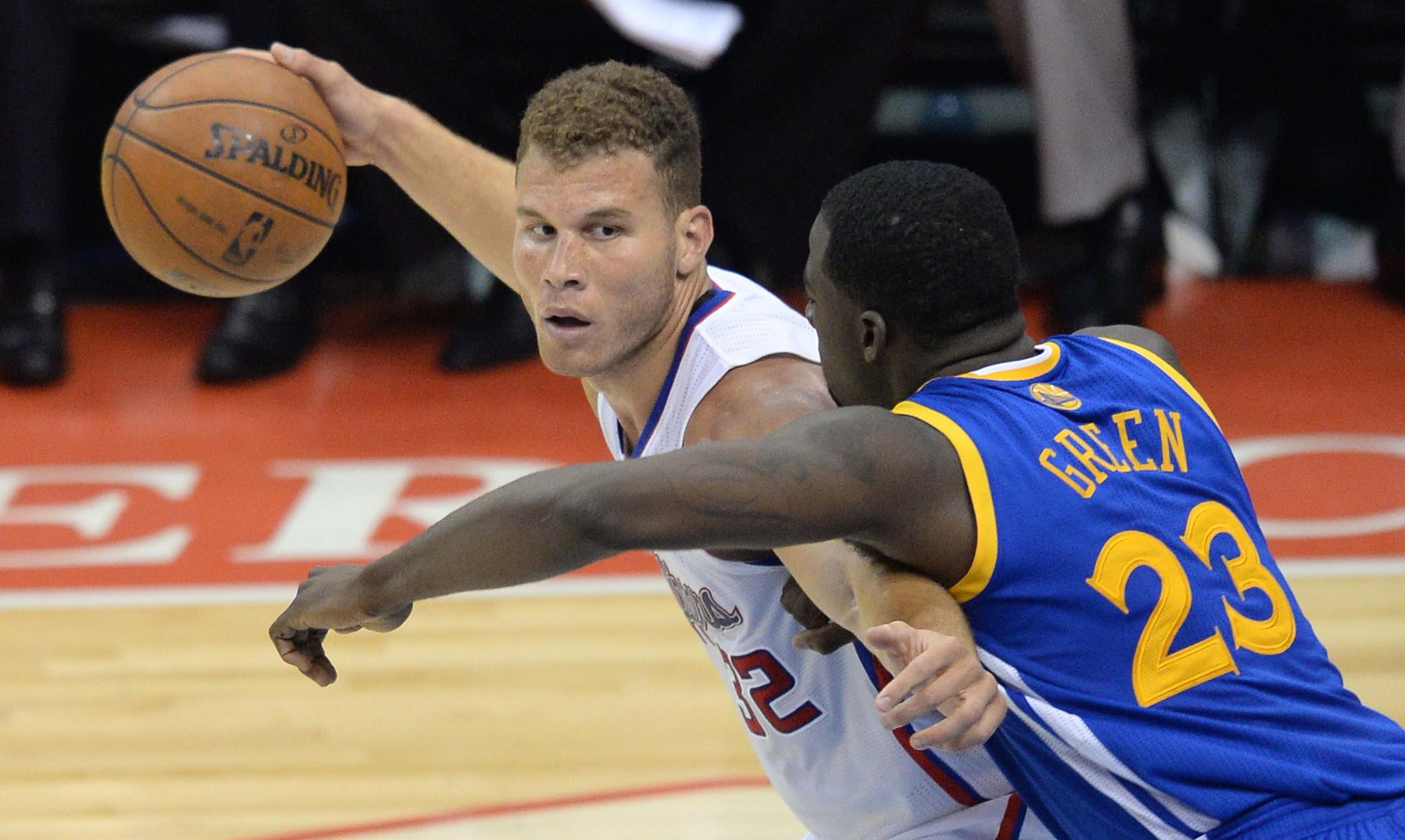 Clippers power forward Blake Griffin, left, keeps the ball away from Golden State Warriors forward Draymond Green during the Clippers' blowout victory in Game 2 of the NBA Western Conference quarterfinals Monday.