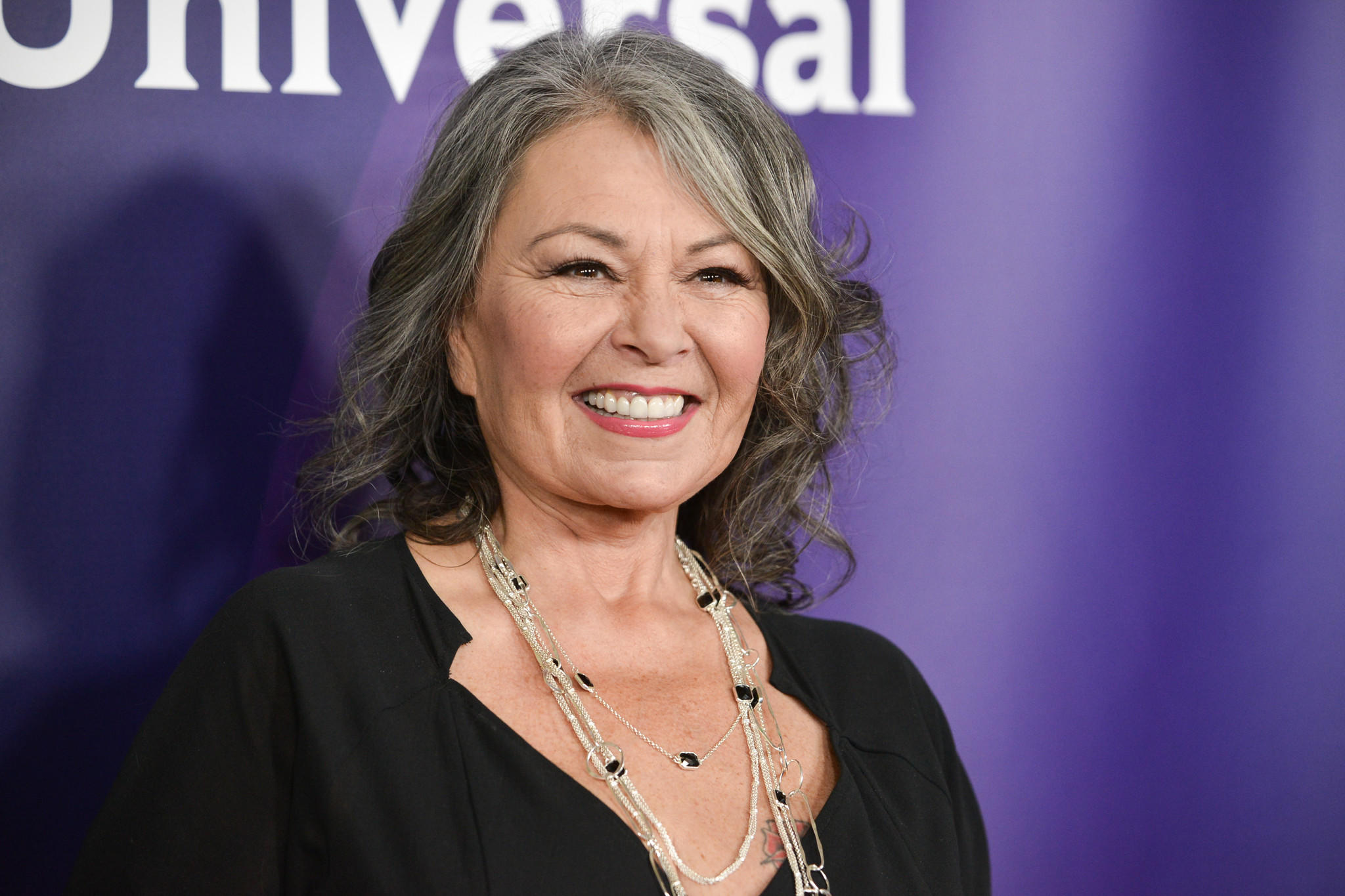 The parents of George Zimmerman have accused Roseanne Barr of posting their address and phone number on Twitter, causing them distress.