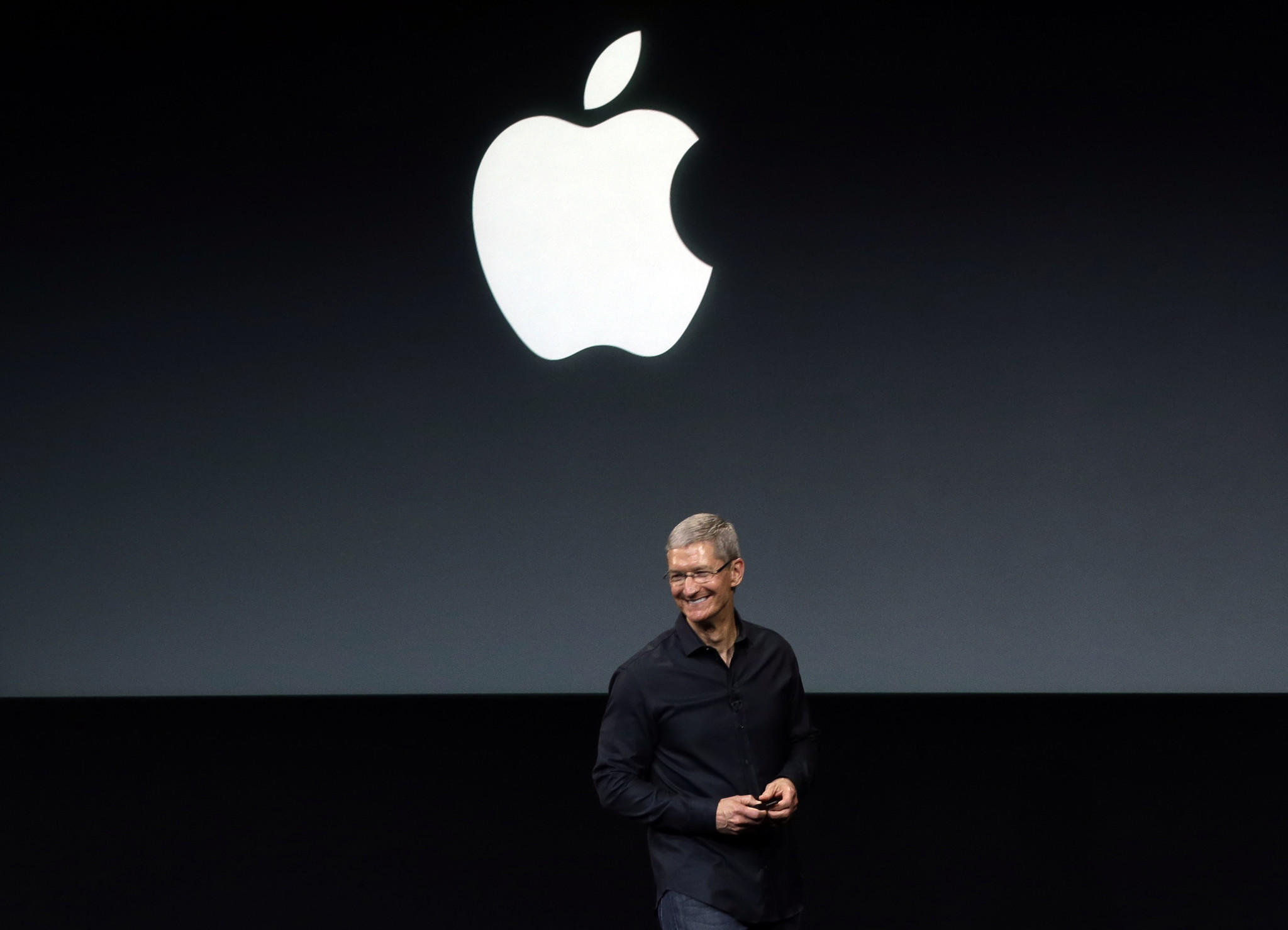 Apple Chief Executive Tim Cook speaks before a new-product introduction in Cupertino, Calif.
