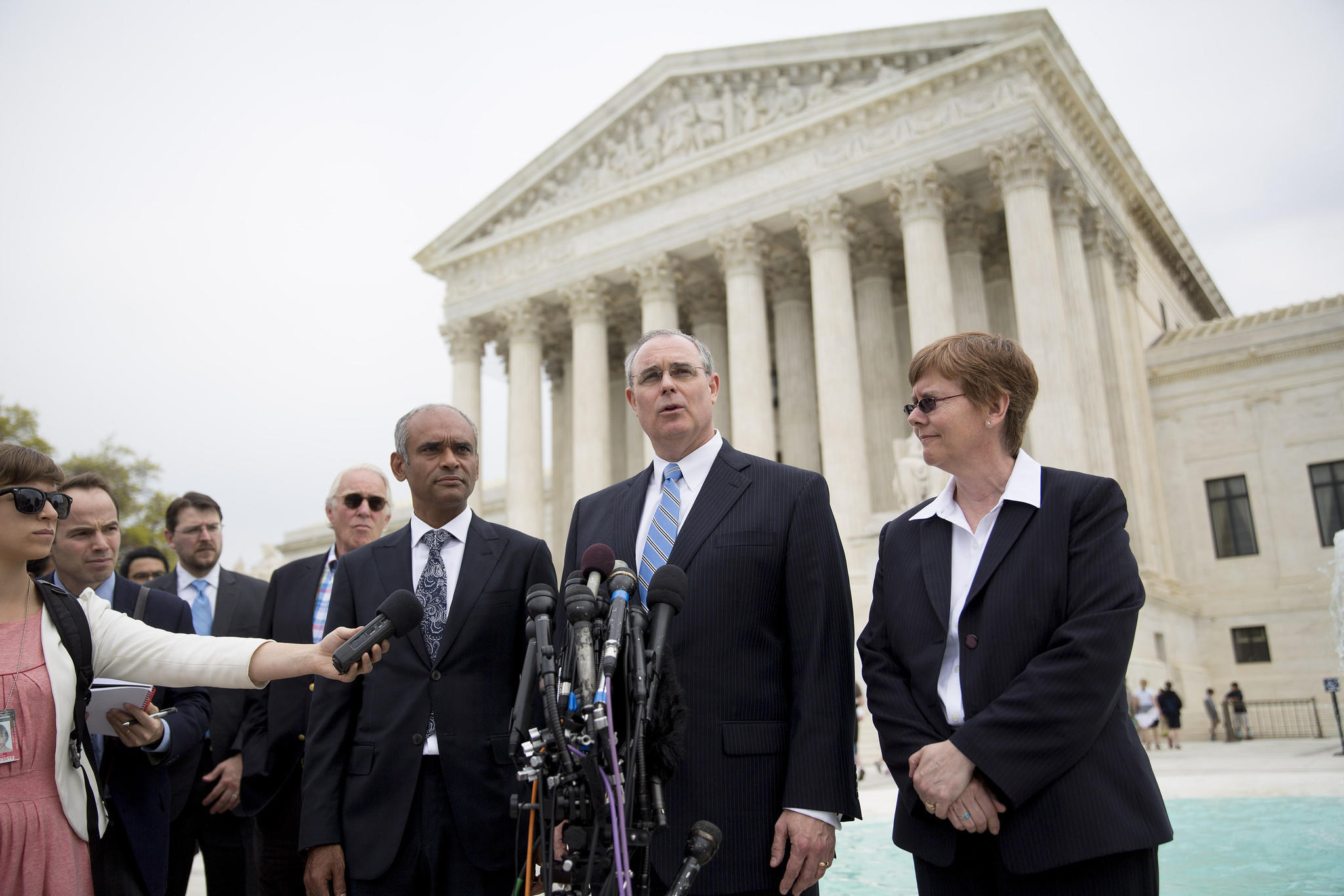 David Frederick, center, outside counsel with Aereo Inc., speaks to the media with Chief Executive Chet Kanojia, left, and General Counsel Brenda Cotter after the Supreme Court heard arguments in the broadcasters' copyright-infringement lawsuit against Aereo.