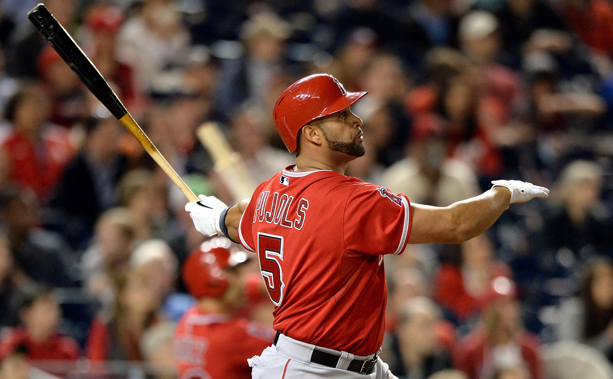 Angels slugger Albert Pujols hits his 500th career home run in the fifth inning of Tuesday's game against the Washington Nationals. Pujols hit his 499th career blast in the first inning.