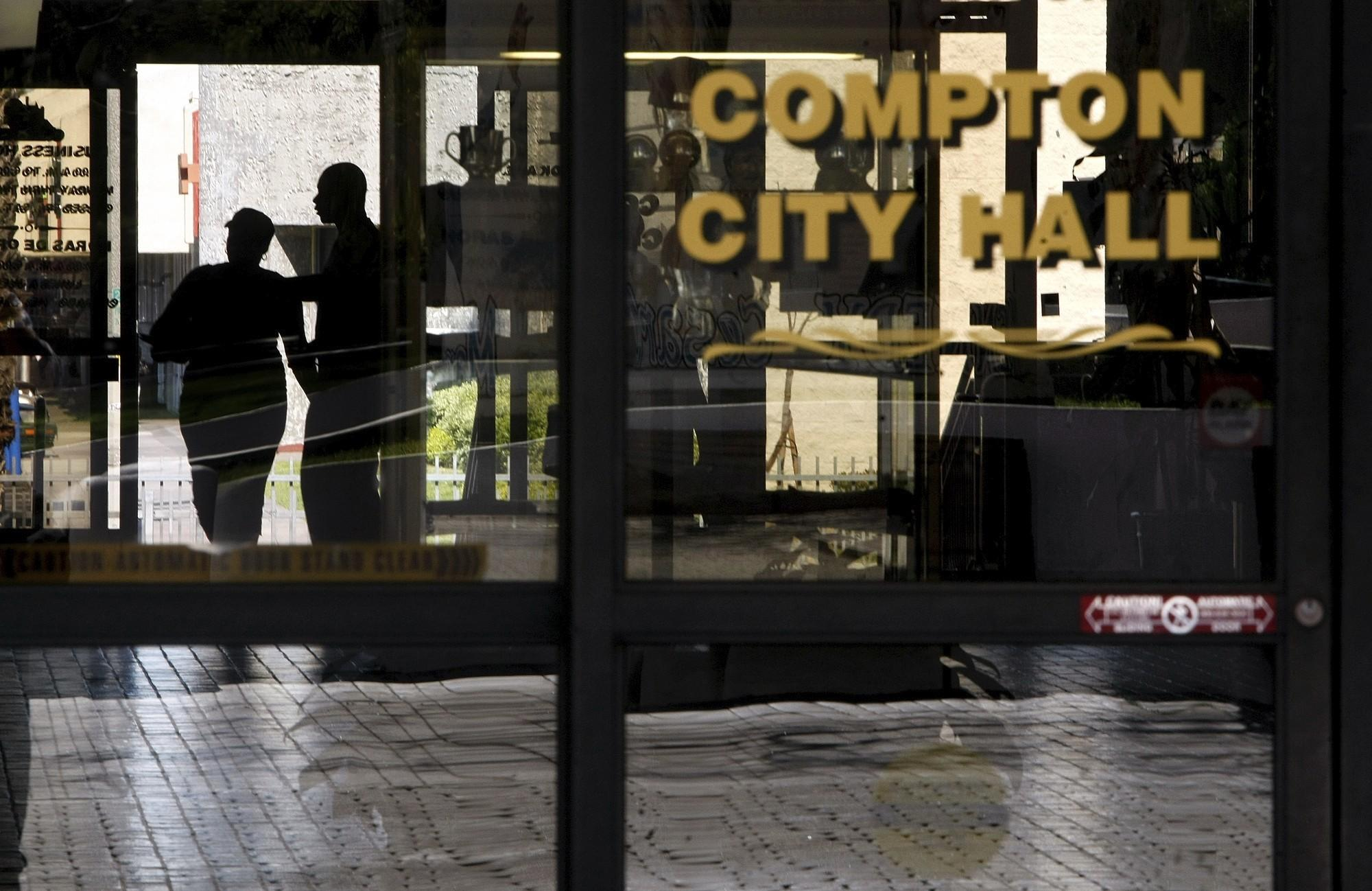 Visitors make their way into Compton City Hall in this 2012 photo.