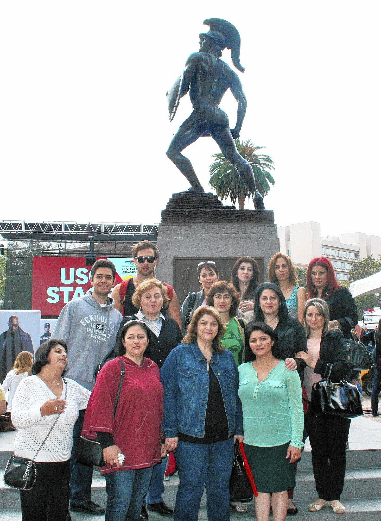 Glendale Community College students pose in front of Tommy Trojan at USC for the Los Angels Times Festival of Books.