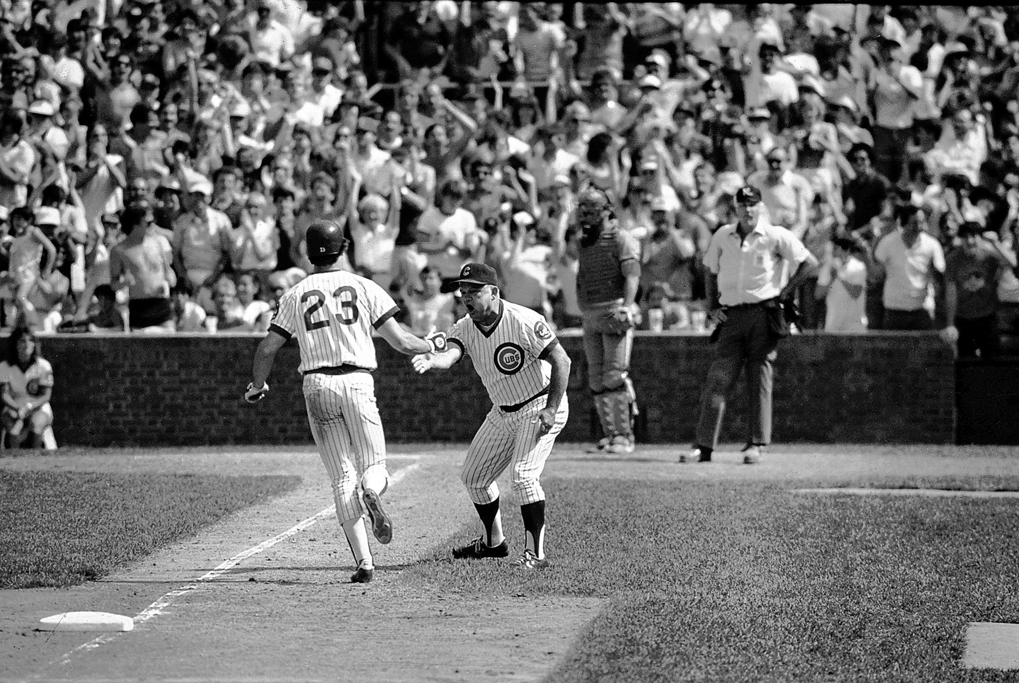 The Cubs' Ryne Sandberg is congratulated by third base coach Don Zimmer after evening the score in the ninth inning with a home run against the Cardinals. Sandburg's big game won RedEye's Best Wrigley Field moments bracket.