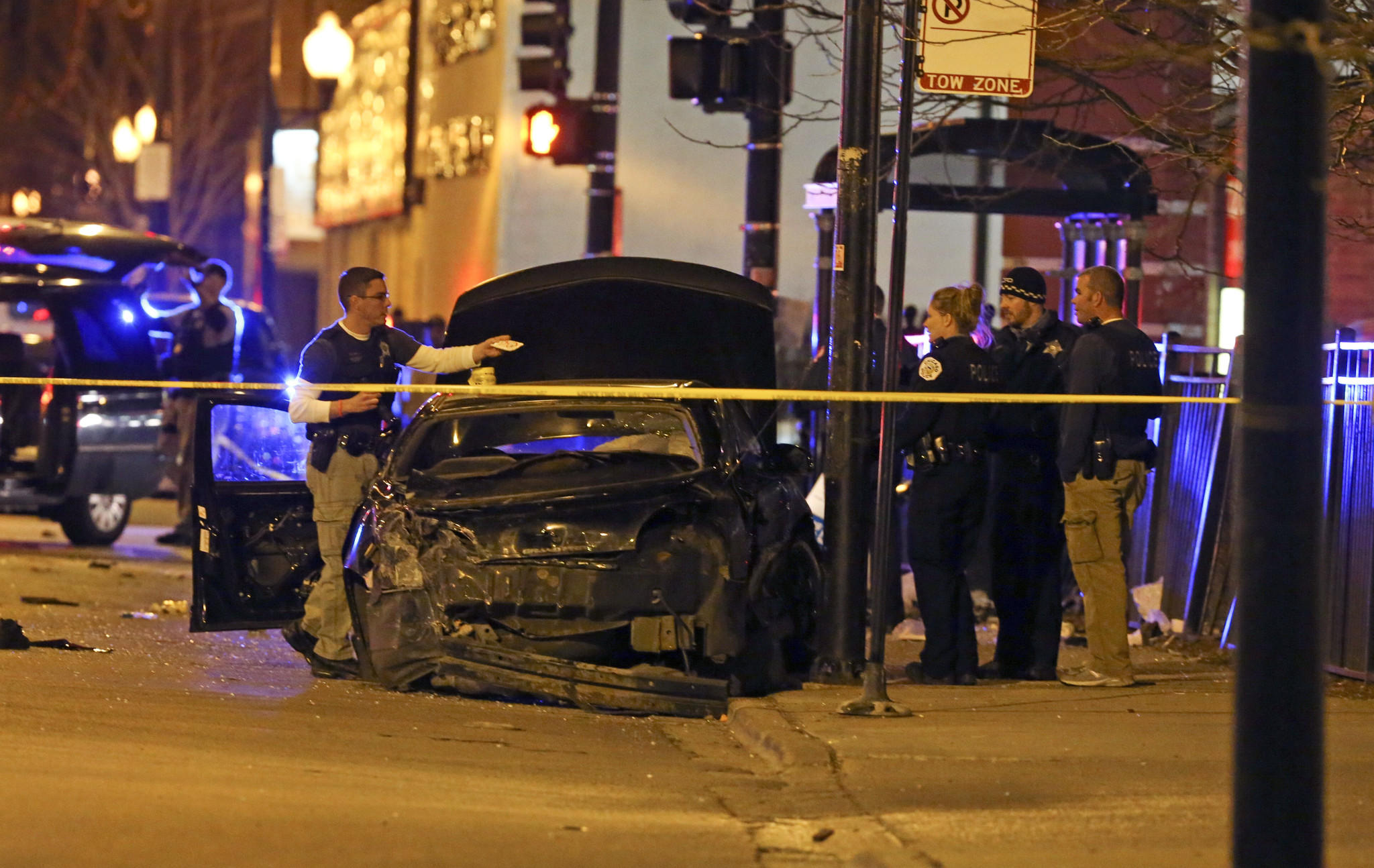 Chicago police work at the scene of a crash in the 13000 block of South Michigan Avenue where multiple people were struck by a vehicle at a bus stop.