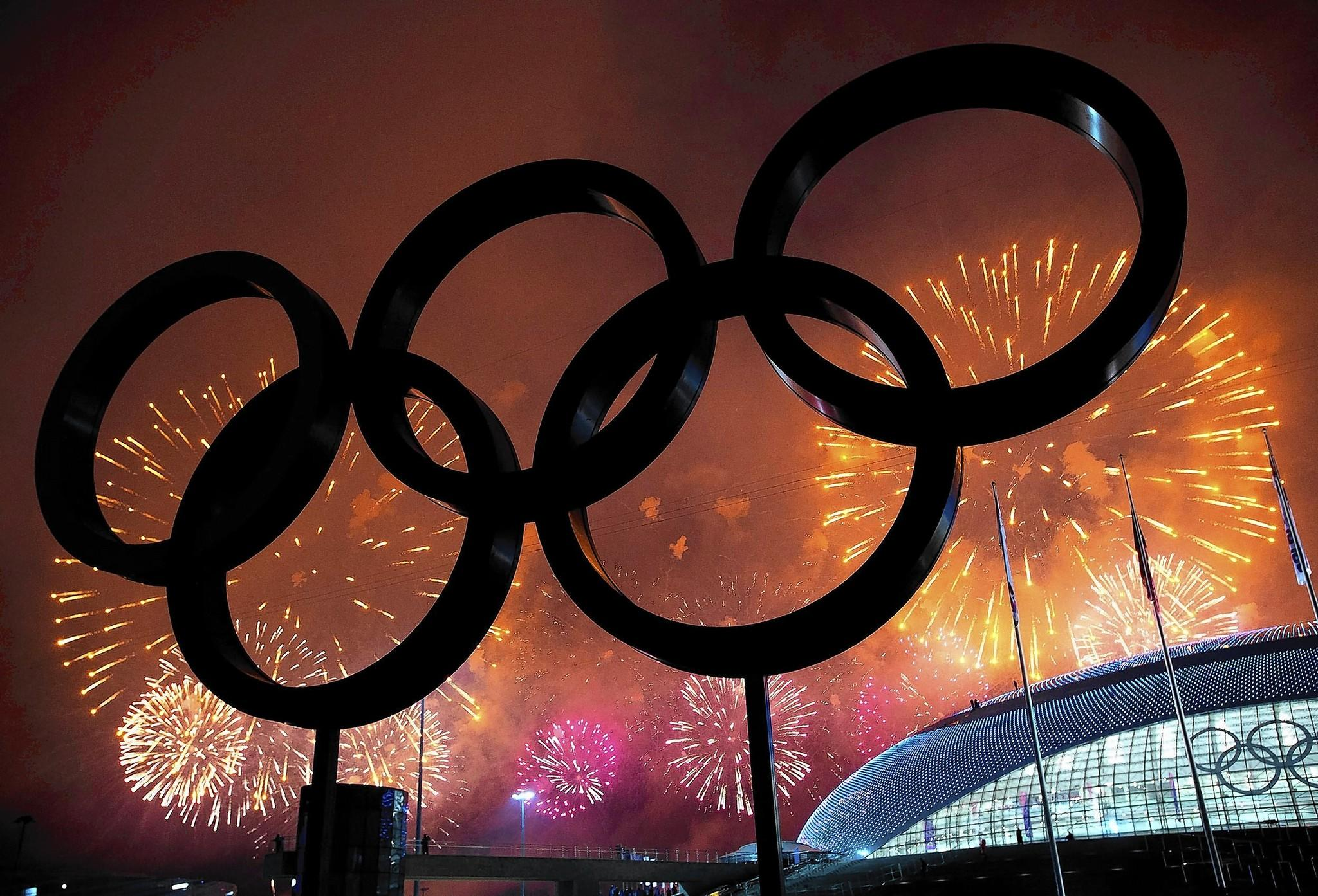 The Olympic Rings are silhouetted as fireworks light up the sky during the closing ceremonies at the 2014 Winter Olympics in Sochi, Russia. NBCUniversal's coverage of the Games brought in $1.1 billion in revenue.