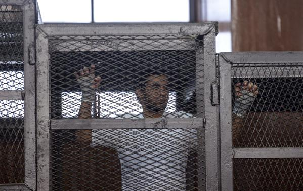 Despite its crackdowns on the press and political parties, Egypt was certified Tuesday to receive U.S. aid. Here, a defendant in custody gestures Tuesday during a trial of 20 people accused of being linked to the banned Muslim Brotherhood.