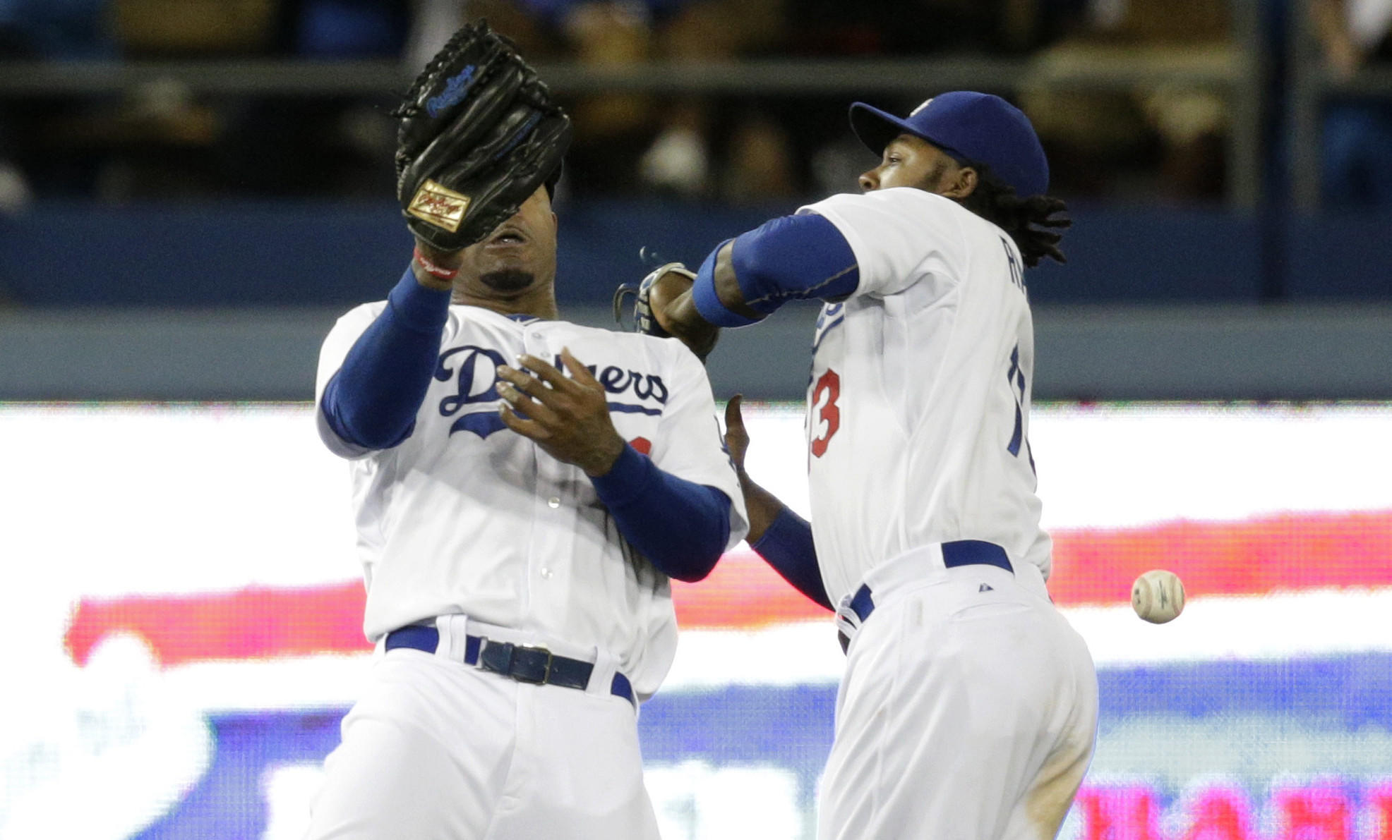Dodgers teammates Hanley Ramirez, left, and Carl Crawford can't make a catch on a ball hit by Philadelphia's Carlos Ruiz during the 10th inning of the Dodgers' 3-2 loss in 10 innings Tuesday.