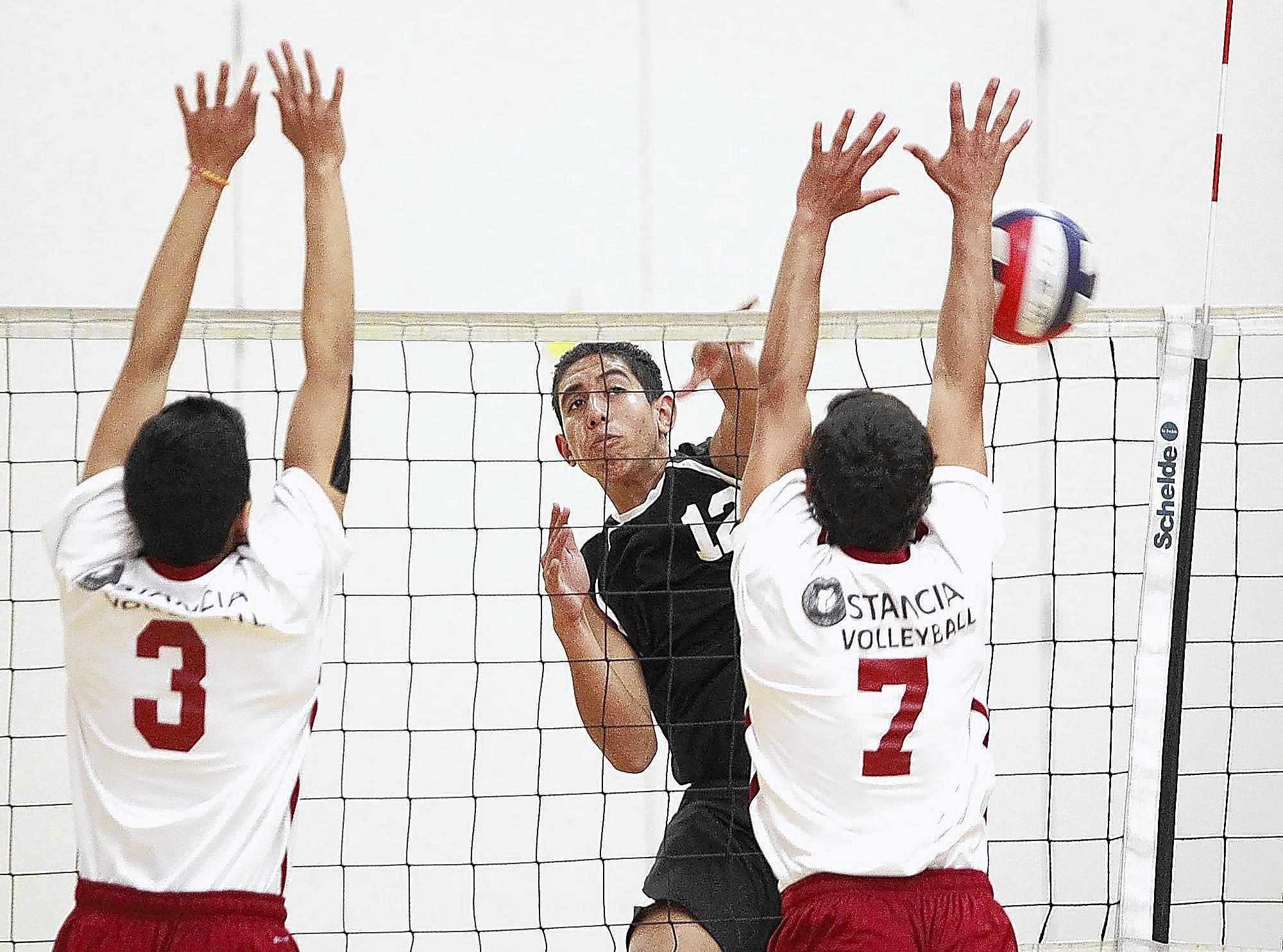 Costa Mesa High's Mason Tufuga puts the ball past Estancia's Dalton O'Daly (7) during an Orange Coast League match on Tuesday at Estancia High.