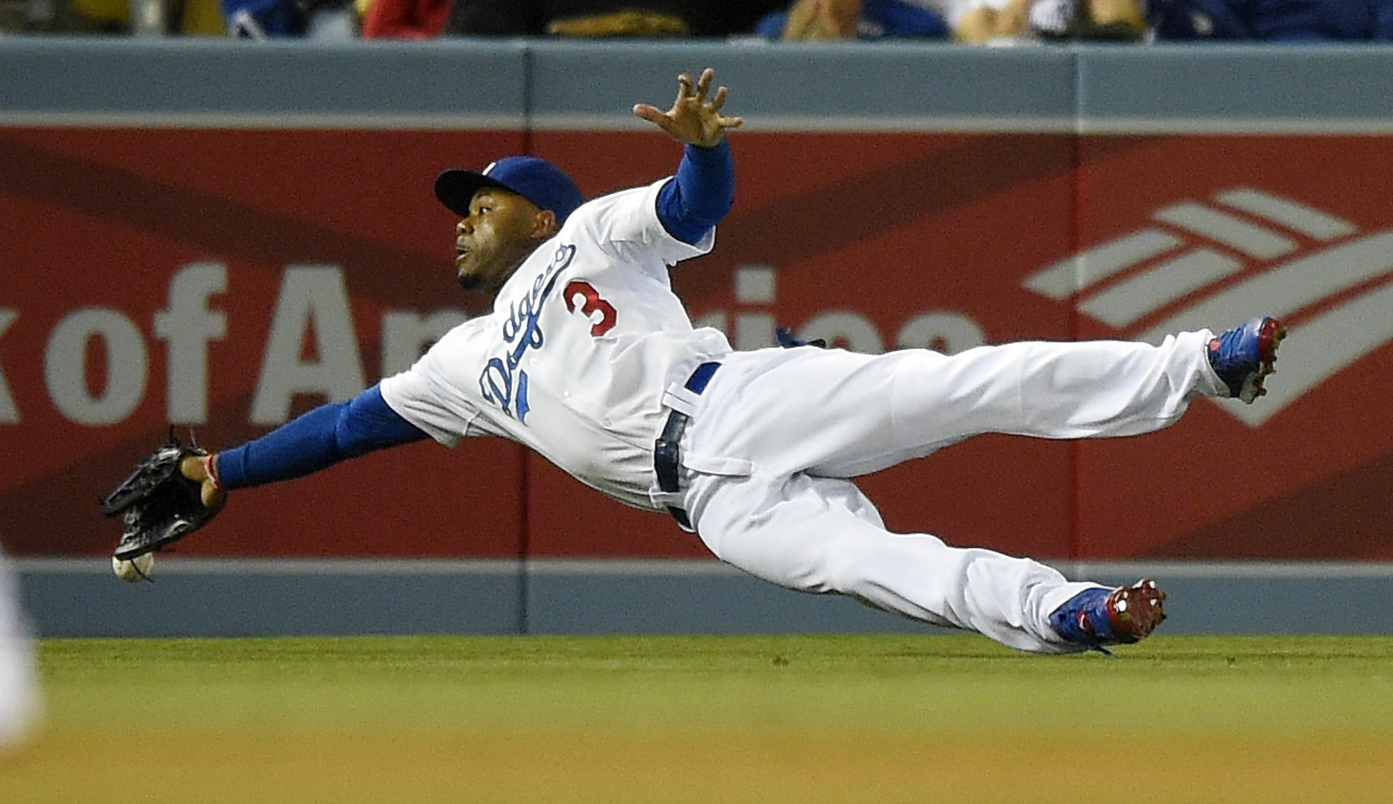 Dodgers left fielder Carl Crawford can't make a diving catch on a double hit by Philadelphia's Chase Utley during Monday's loss. Crawford also was involved in a fielding mishap Tuesday that played a big role in another loss to the Phillies.