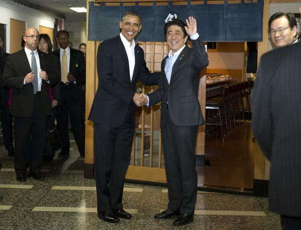 President Obama and Japanese Prime Minister Shinzo Abe shake hands before having dinner at the Sukiyabashi Jiro sushi restaurant in Tokyo.