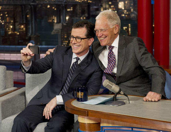 "Comedy Central's Stephen Colbert, left, takes a selfie with host David Letterman on the set of the ""Late Show with David Letterman"" on Tuesday."